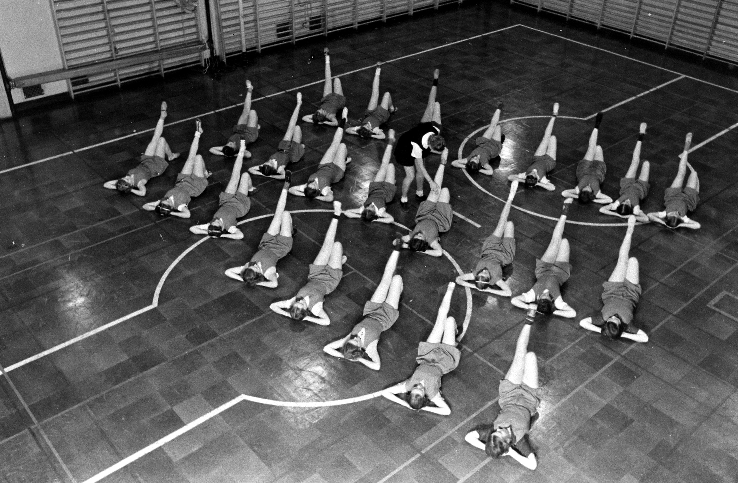 <b>Caption from LIFE.</b> During their first six months student nurses must take calisthenics one night a week under a trained gym teacher.