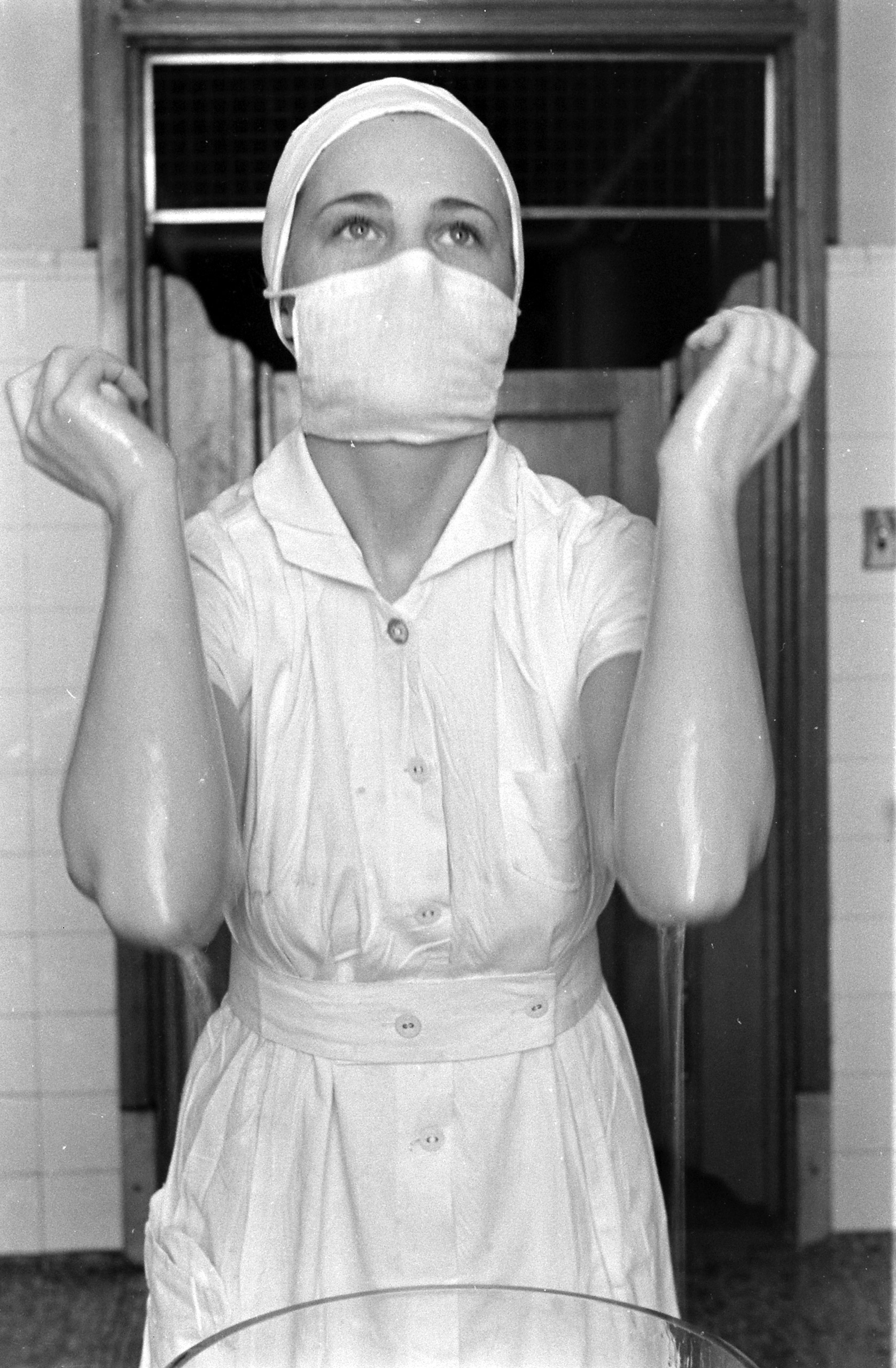 <b>Caption from LIFE.</b> Operating room duty is the most interesting part of a nurse's life. Not till the end of her first year is she considered prepared for it.
