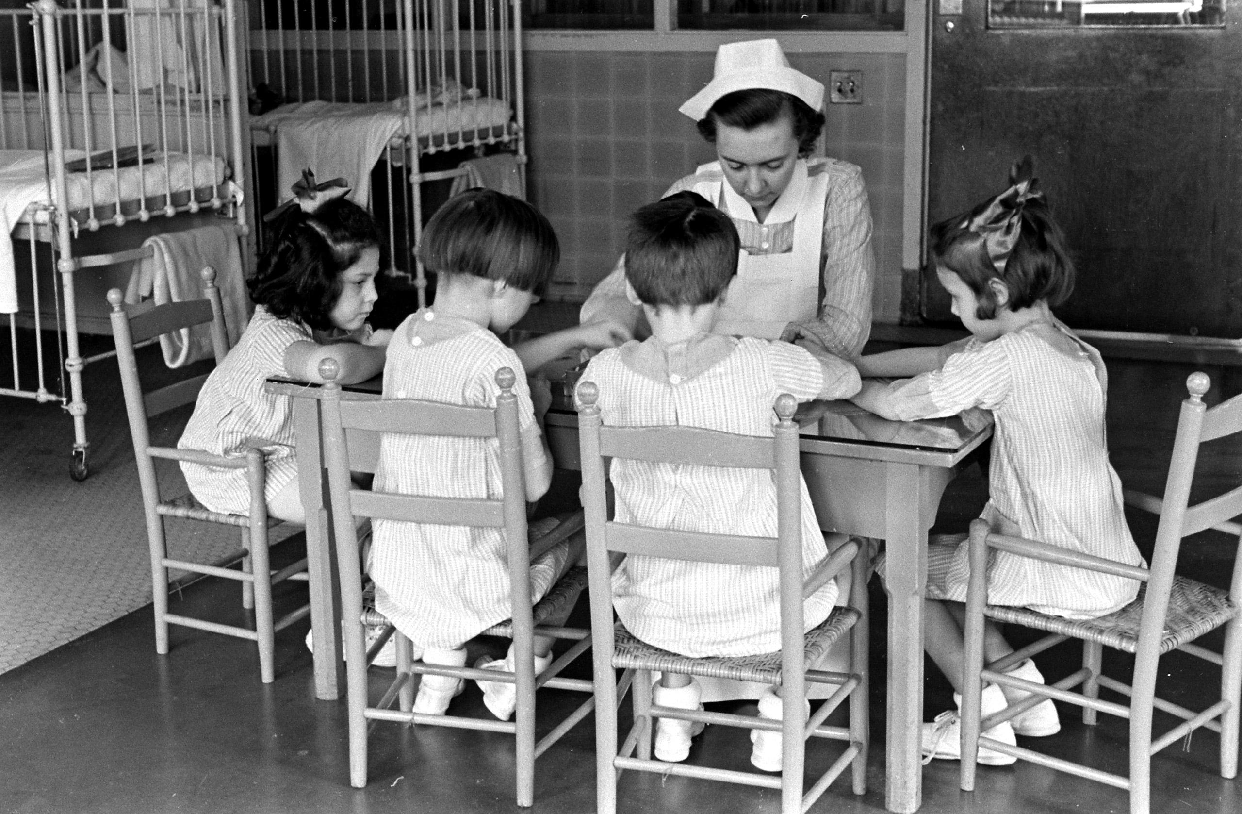 Student nurse with children at New York's Roosevelt Hospital, 1938.