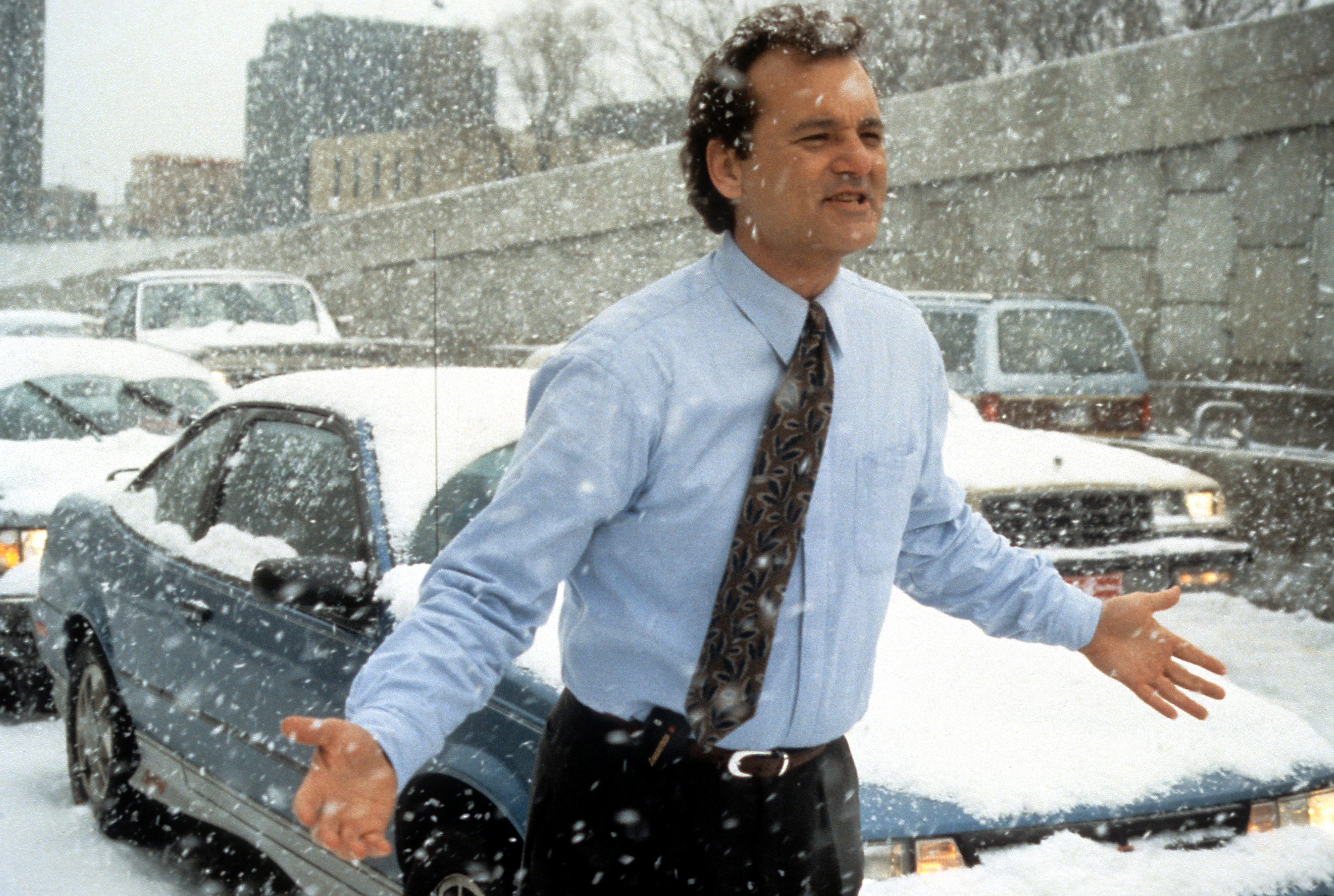 Bill Murray runs through the snow in a scene from the film Groundhog Day in 1993.