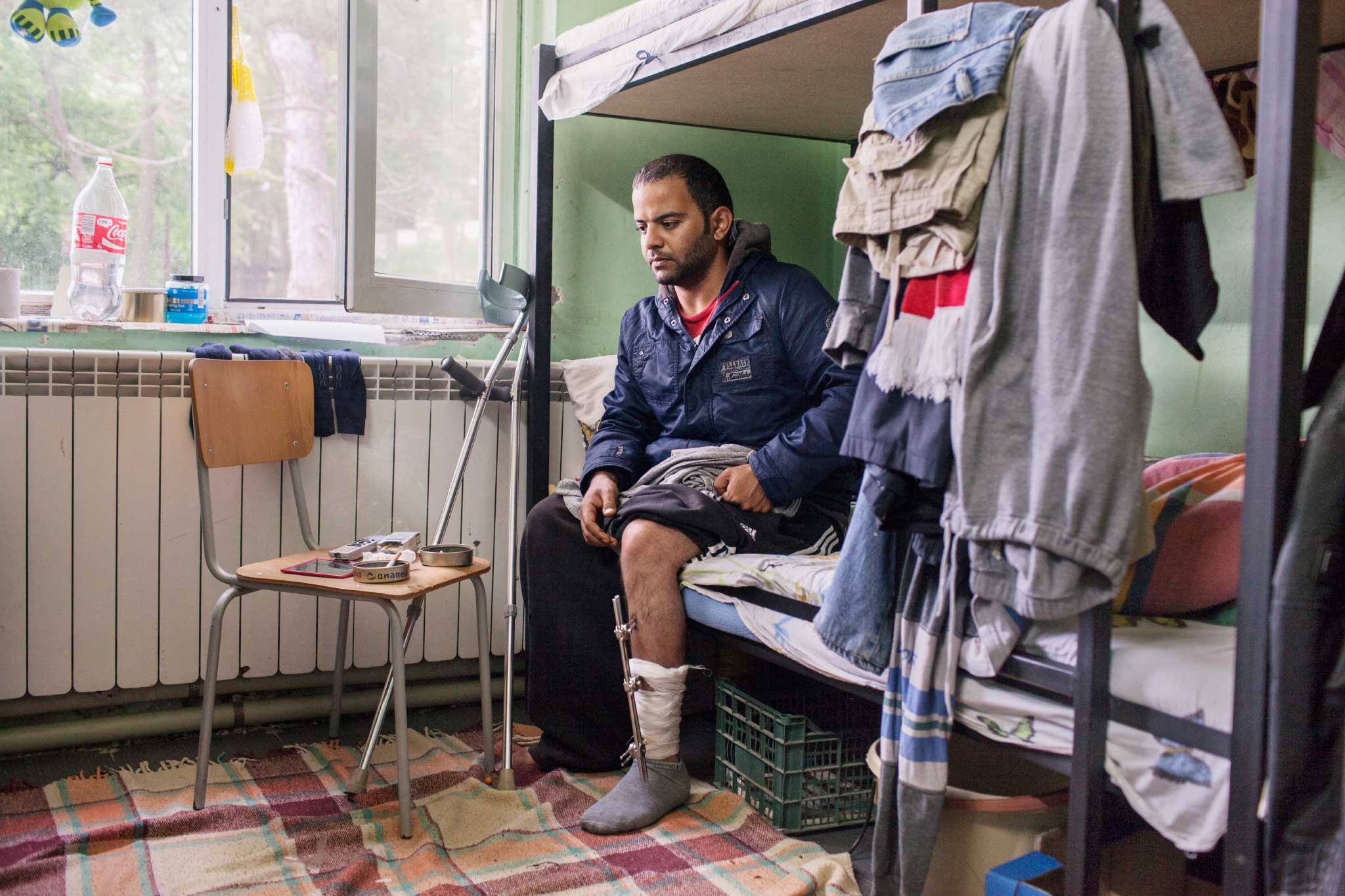 Nezarisa Sakhi, a 31-year-old Iraqi, in Banya refugee center in Bulgaria on May 16, 2014. Sakhi was attacked on the evening of Sept. 16, 2013 by nine Bulgarians, one of whom Nezarisa says had a knife. He was beaten and pushed off a bridge, breaking his leg.