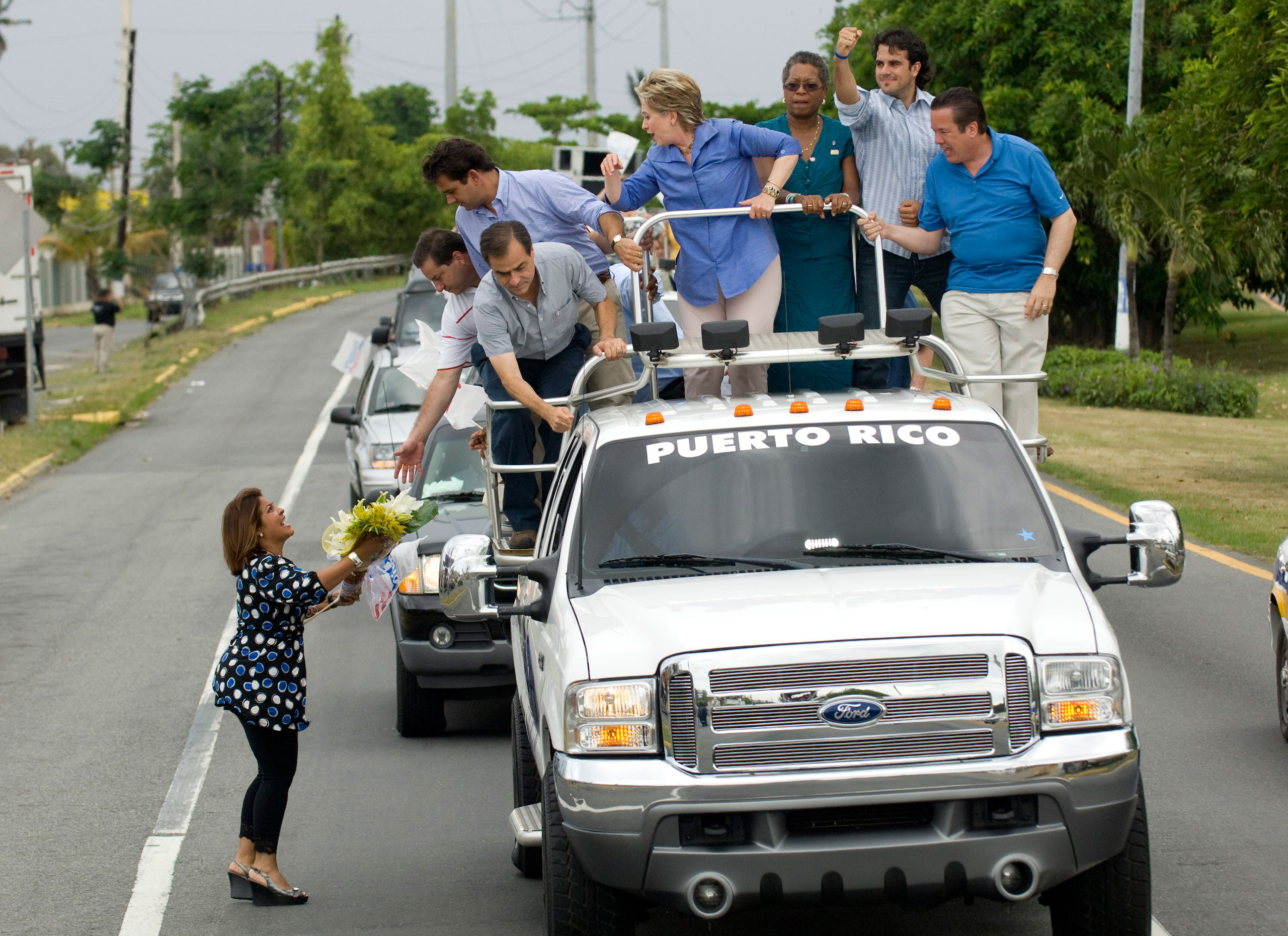 A campaign stop in Puerto Rico during the 2008 presidential elections. It's tradition that candidates ride through town on a truck with music blaring.
