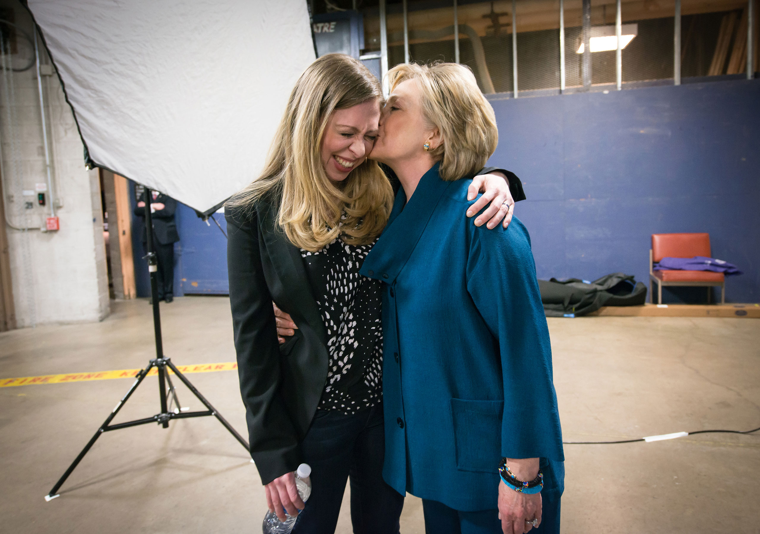 Chelsea Clinton and her mother, Secretary of State Hillary Clinton, share a moment backstage at the Clinton Global Initiative University meeting at Arizona State University in Tempe, Ariz., March 22, 2014.