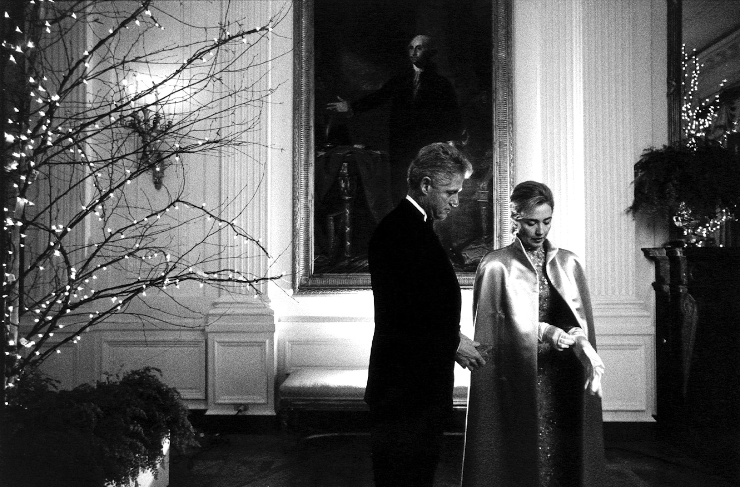 President Bill Clinton and First Lady Hillary Rodham Clinton prepare for a formal portrait in the East Room of the White House on the evening of the President's second inauguration, Jan. 20, 1997.
