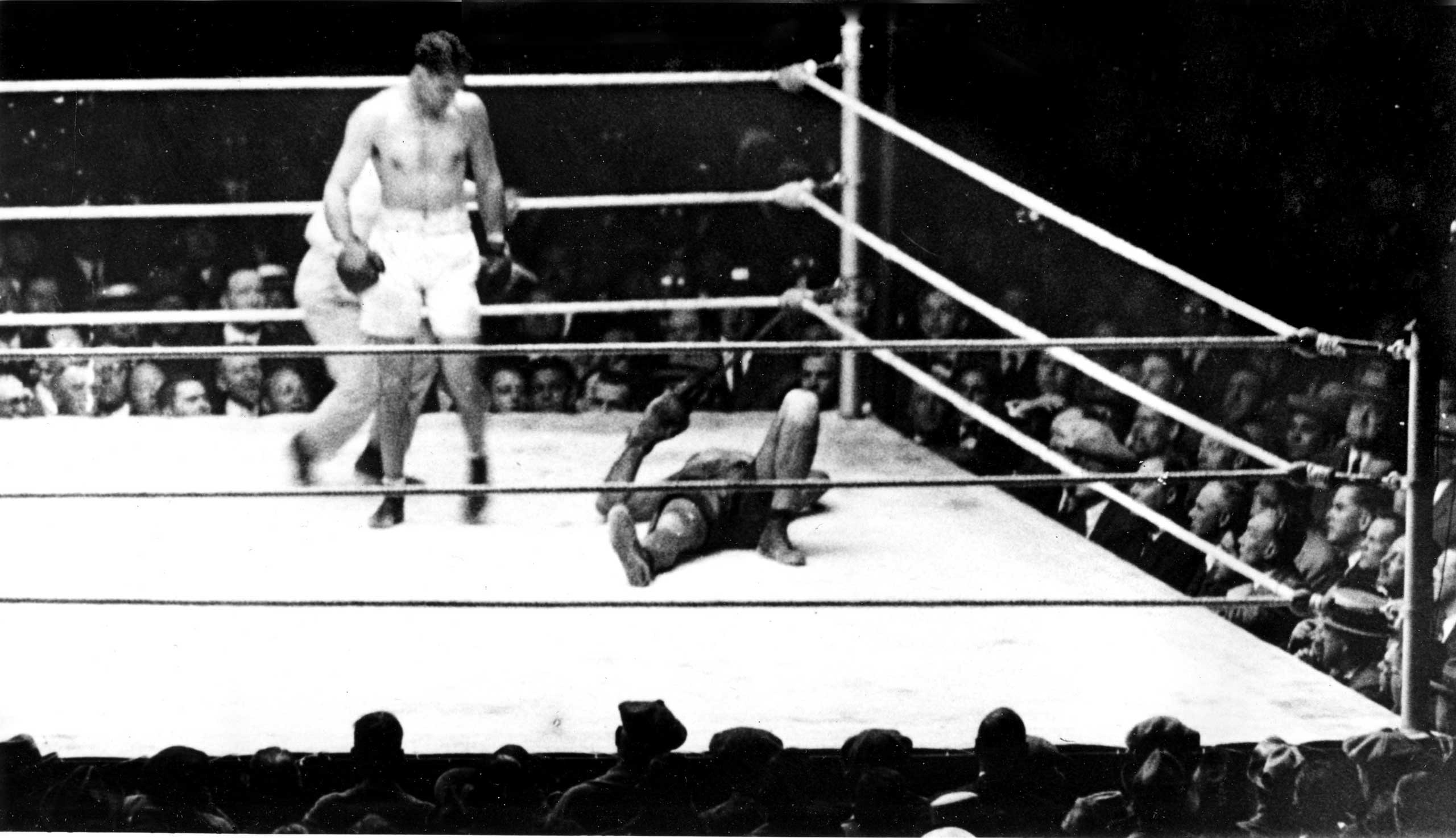 "<b>Jack Dempsey vs. Luis Angel Firpo, Sept. 14, 1923</b> Short and sweet. That's how you'd have to describe heavyweight champ Jack Dempsey's defense of his title against Luis Angel Firpo, the ""Wild Bull"" of the Pampas, before 80,000 people at the Polo Grounds in New York. Dempsey floored Firpo seven times, with Firpo knocking Dempsey clean out of the ring — and that was just the first round (there was no three knockdown rules back then. Indeed, Dempsey was allowed to stand over the fallen fighter and immediately knock Firpo down again, as there wasn't a rule about going to a neutral corner either). Conspiracy theorists believe that Firpo was denied a valid victory in the first round as Dempsey was helped back into the ring by the writers at ringside and the referee was accused of counting incredibly slowly. Nevertheless, after 11 total knockdowns between the pair, Dempsey won by KO in the second. The fight was also important from a historical perspective because it was the first time that a Latin American boxer would fight for the world heavyweight title."
