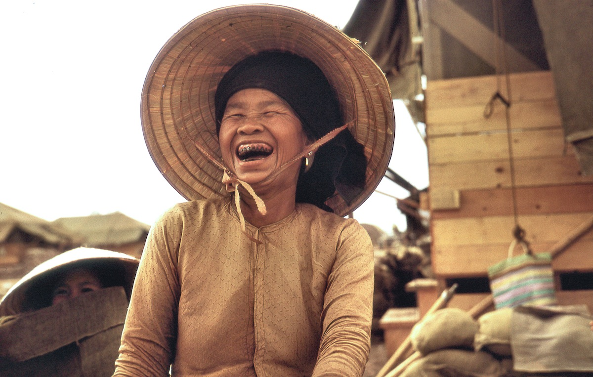 "Mama San, 1967: ""A term used by GIs in Vietnam for any older Vietnamese woman. In this case she was supervising 'sandbag dollies,' younger Vietnamese women who were working at the base camp in Dau Tieng."""