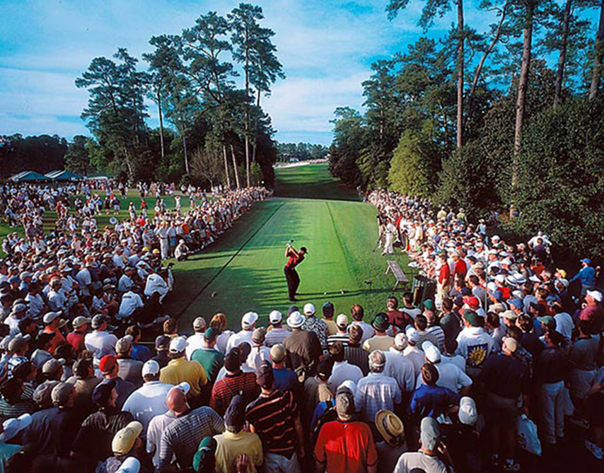 This photo of Woods teeing off on 18 during the final round of the 2001 Masters made the cover of Sports Illustrated. <b><i>Click to see more of Sports Illustrated's 100 Best Masters Photos on golf.com</b></i>