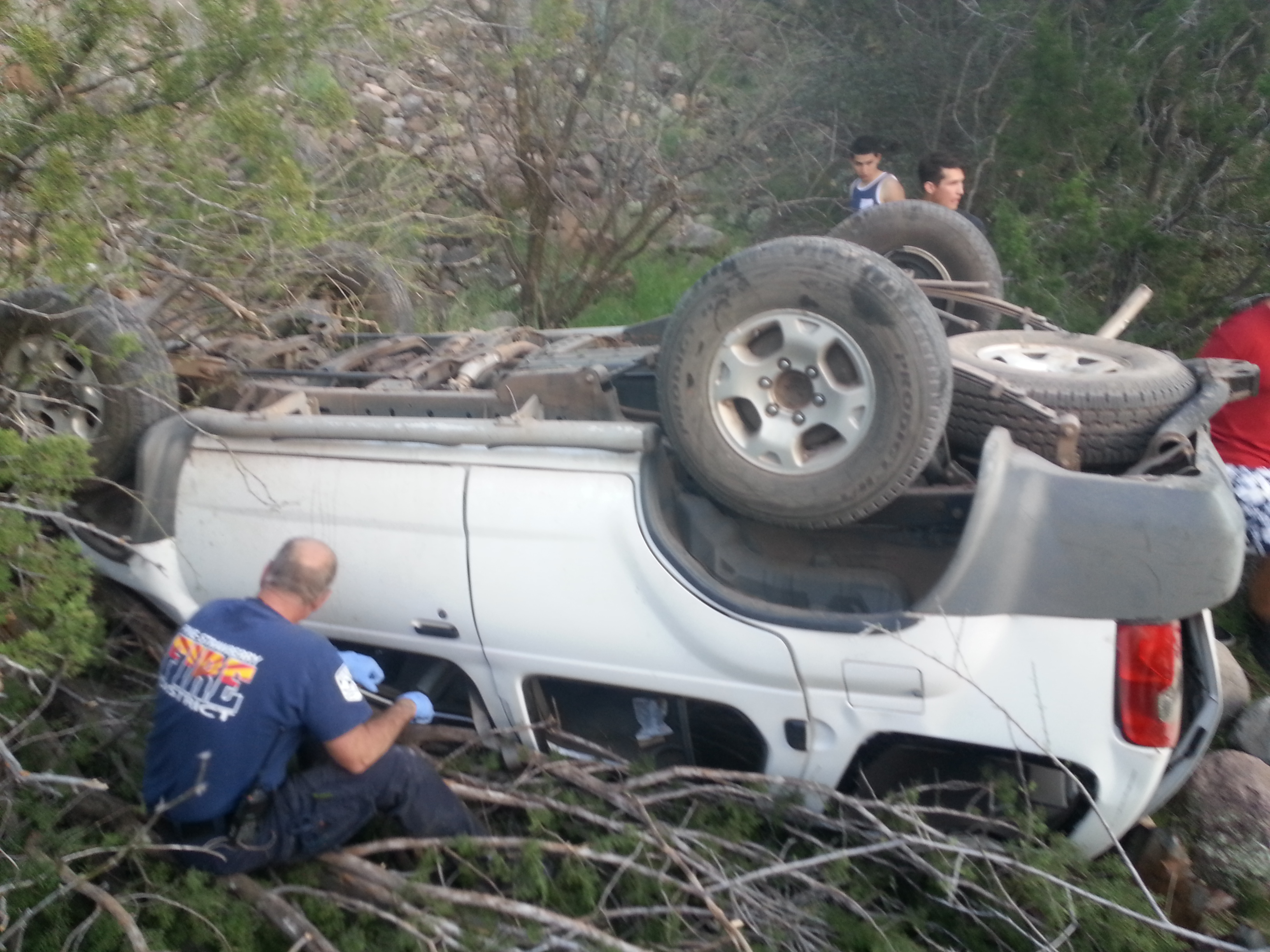 The driver involved in the accident was trapped under the overturned vehicle for approximately four hours until firefighters were able to extricate her on April 1, 2015.