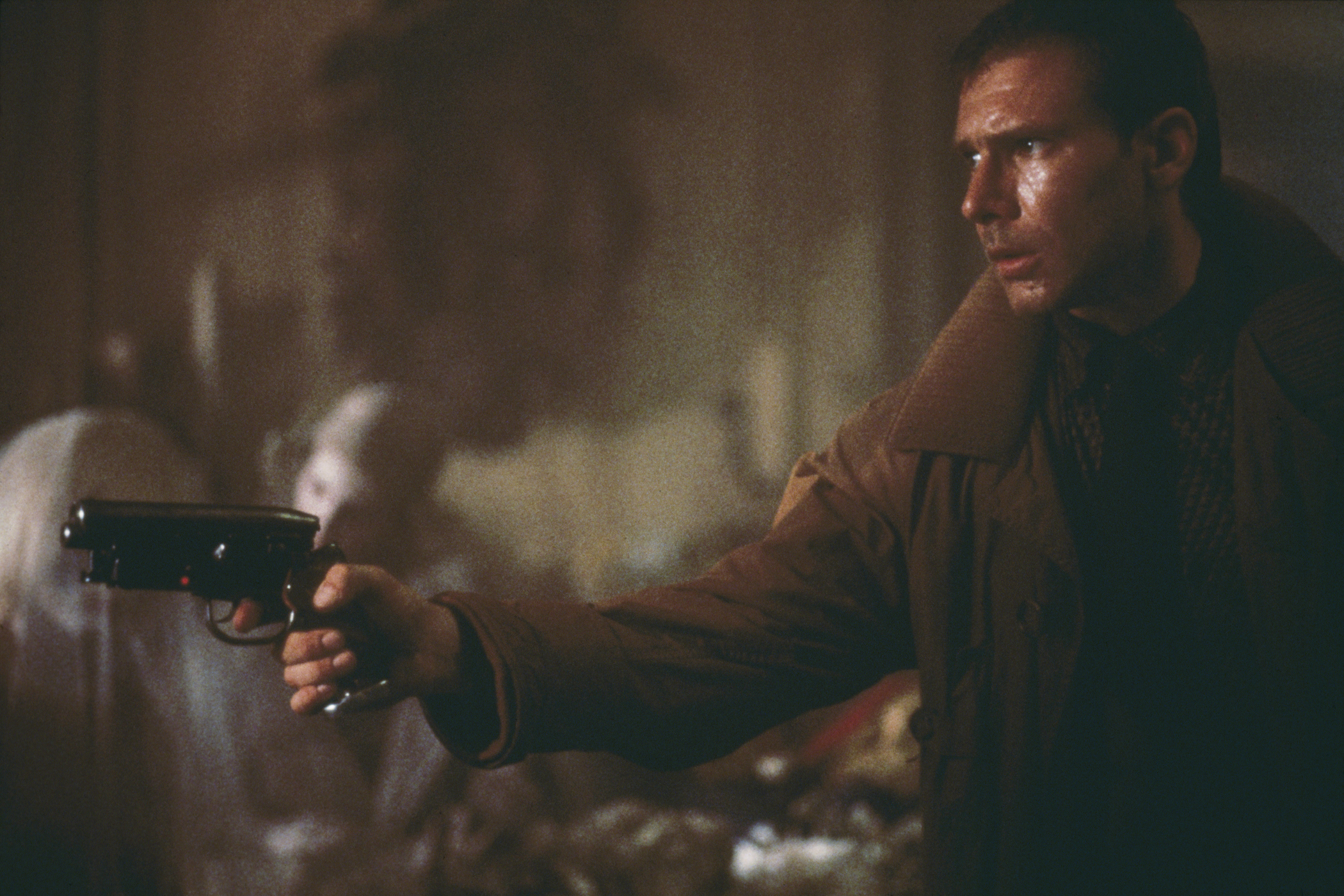 'Blade runner' Rick Deckard (Harrison Ford) enters Sebastian's apartment, where he is soon to be attacked by the replicant Pris (Daryl Hannah, immediately behind Deckard's gun), in a scene from Ridley Scott's futuristic thriller 'Blade Runner', 1982.