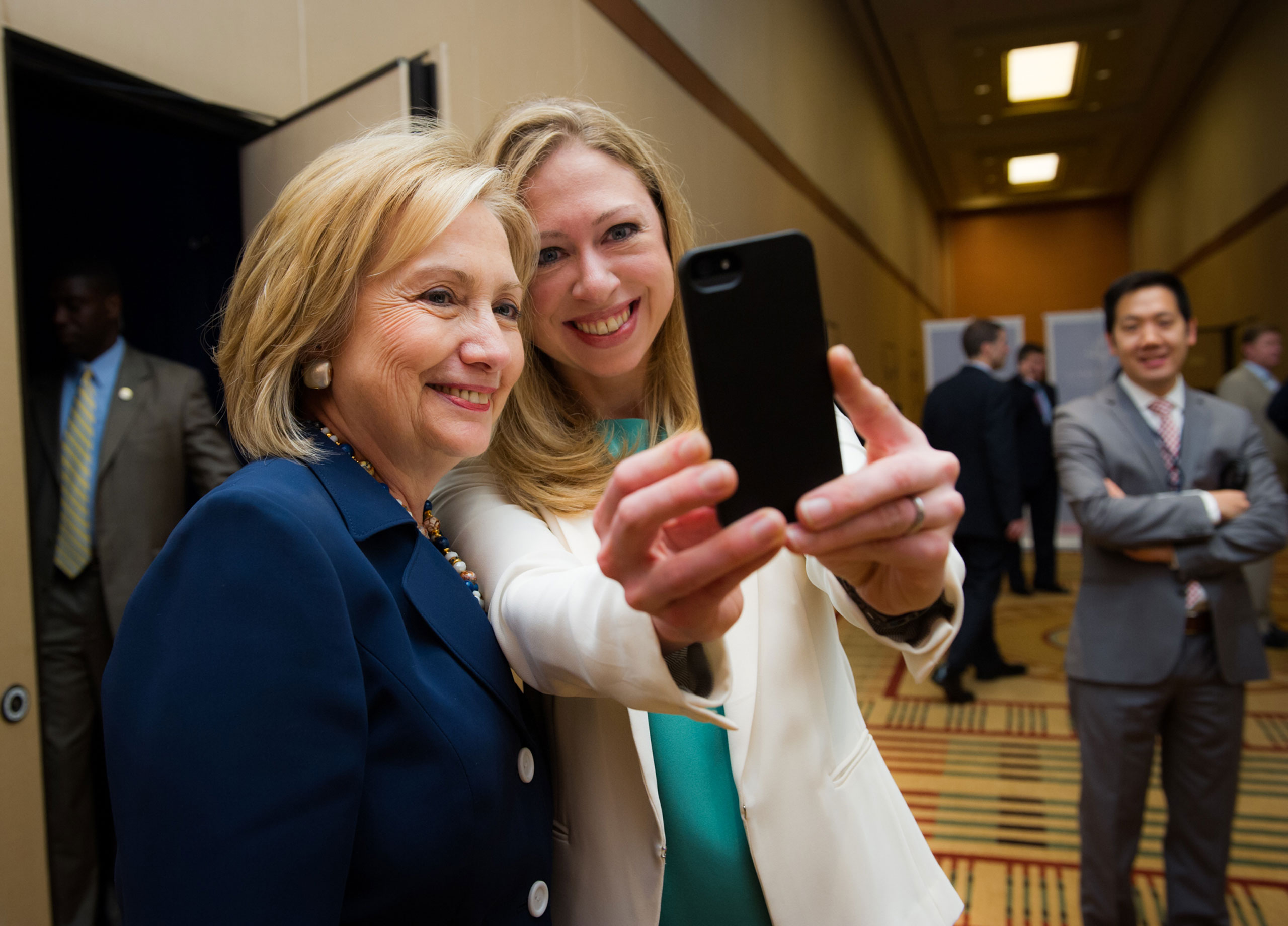 At a Clinton Global Initiative meeting. Secretary of State Hillary Clinton and Chelsea take a selfie.