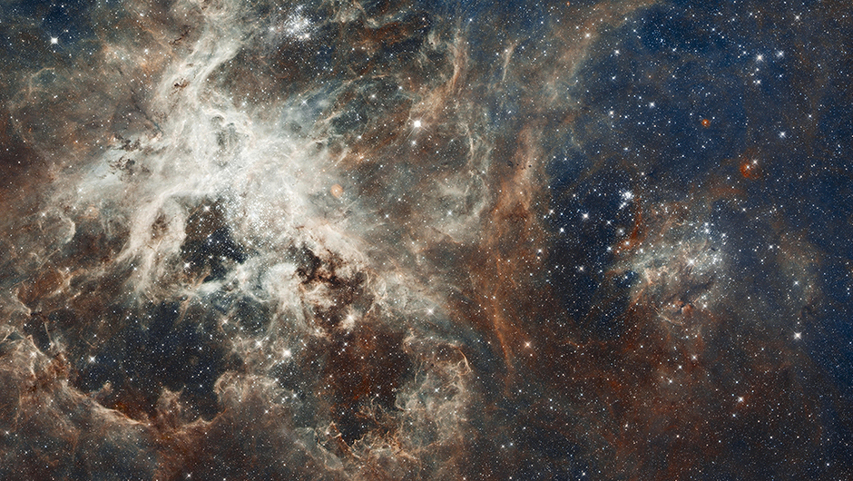 30 Doradus:                               This stellar breeding ground is located in the heart of the Tarantula Nebula. 30 Doradus is the brightest star-forming region visible in a neighboring galaxy and home to the most massive stars ever seen. The nebula resides 170,000 light-years away in the Large Magellanic Cloud, a small, satellite galaxy of our Milky Way. No known star-forming region in our galaxy is as large or as prolific as 30 Doradus.                                                               The composite image comprises one of the largest mosaics ever assembled from Hubble photos.                               Image released on April 17, 2012
