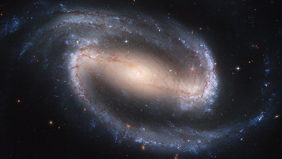 <strong>Barred Spiral Galaxy NGC 1300</strong>:                                                                      This is one of the largest Hubble Space Telescope images ever made of a complete galaxy. NGC 1300 is considered to be prototypical of barred spiral galaxies, which differ from normal spiral galaxies in that the arms do not spiral all the way into the center, but are connected to the two ends of a straight bar of stars containing the nucleus at its center.                                                                      <i>Image released on Jan. 10, 2005</i>