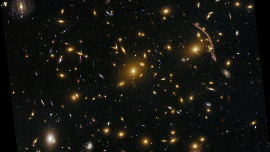 Abell 370:                                                              This is one of the very first galaxy clusters where astronomers observed the phenomenon of gravitational lensing, where the warping of space by the cluster's gravitational field distorts the light from galaxies lying far behind it. This is manifested as arcs and streaks in the picture, which are the stretched images of background galaxies. Gravitational lensing proves a vital tool for astronomers when measuring the dark matter distribution in massive clusters.                                                              Image released on Sept. 9, 2009