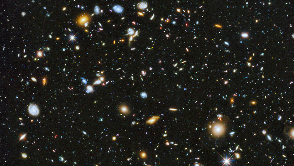 <strong>The Most Colorful View of the Universe</strong>:                                                                      Astronomers using NASA's Hubble Space Telescope assembled a comprehensive picture of the evolving universe among the most colorful deep space images ever captured by the telescope. The image is a composite of separate exposures taken in 2002 to 2012 with Hubble's Advanced Camera for Surveys and Wide Field Camera 3. The resulting image - made from 841 orbits of telescope viewing time - contains approximately 10,000 galaxies, extending back in time to within a few hundred million years of the big bang.                                                                       <i>Image released on June 3, 2014</i>