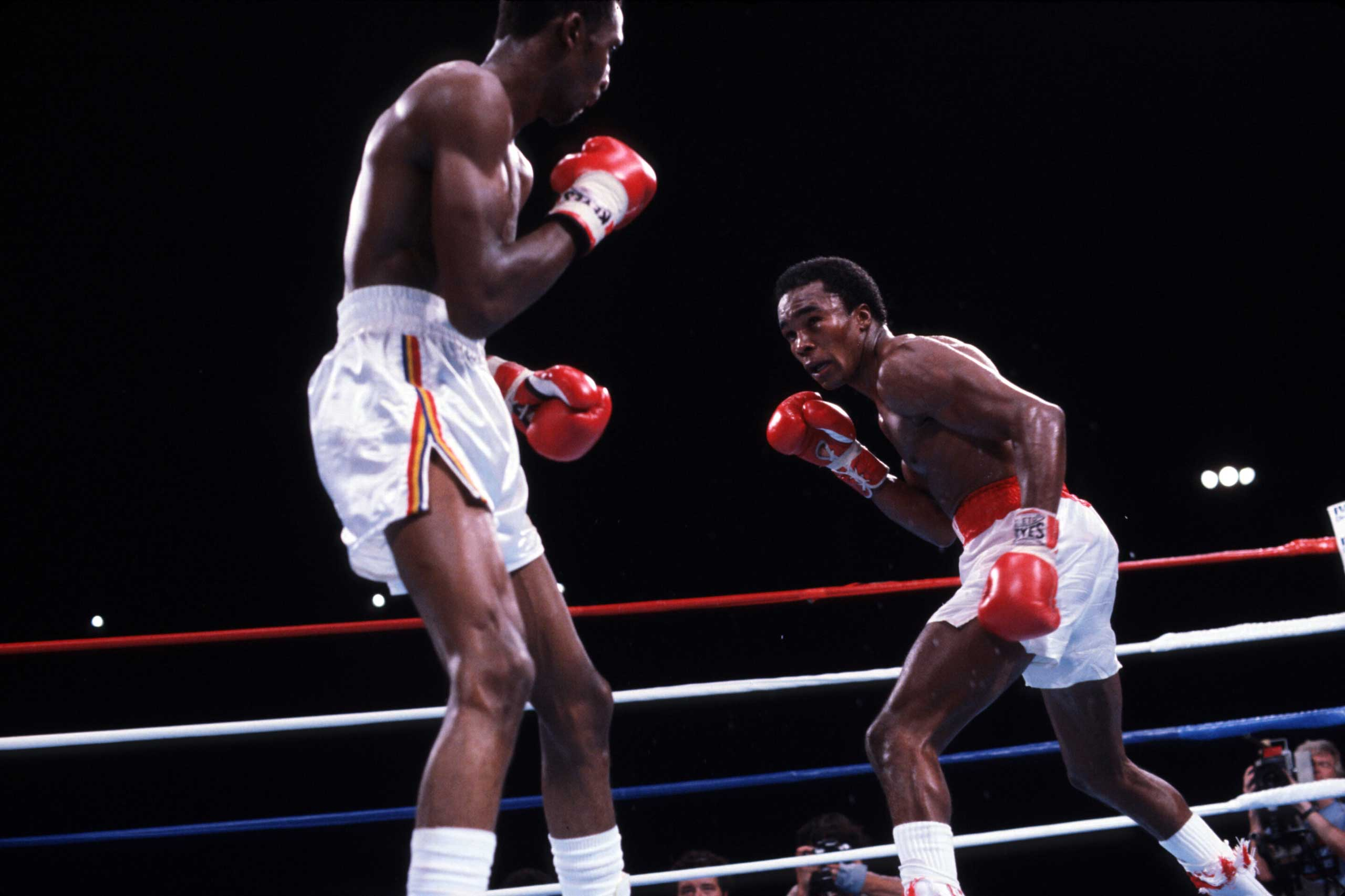 "<b>Sugar Ray Leonard, Sept. 16, 1981</b> This early 80s showdown at Caesars Palace in Las Vegas — billed as ""The Showdown"" — between WBC welterweight champ ""Sugar"" Ray Leonard and the hitherto undefeated Thomas ""Hitman"" Hearns, owner of the WBA crown, was a fight of beauty, full of an ebb and flow throughout. They were fighting to unify the World Welterweight Championship and the stakes couldn't have been higher. First Hearns, then Leonard and then Hearns again held the lead. Between rounds 12 and 13, Leonard's trainer, the legendary Angelo Dundee, exclaimed ""You're blowing it, son! You're blowing it!"" Leonard simply exploded in the 13th, knocking Hearns through the ropes. He didn't relent and finished him off in the 14th with a furious flurry of punches that forced referee Davey Pearl to call a halt to proceedings. Even worse for Hearns was that he was actually leading on all the judges' scorecards up to that point."