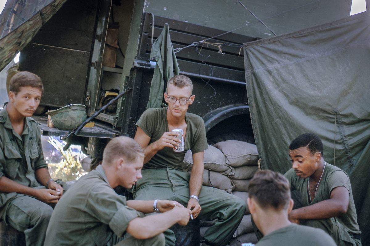 "Floating Poker Game, 1967: ""My buddy and fellow Team Chief, Sgt. Dick Jackson (holding beer can) separates the troops from their pay."""