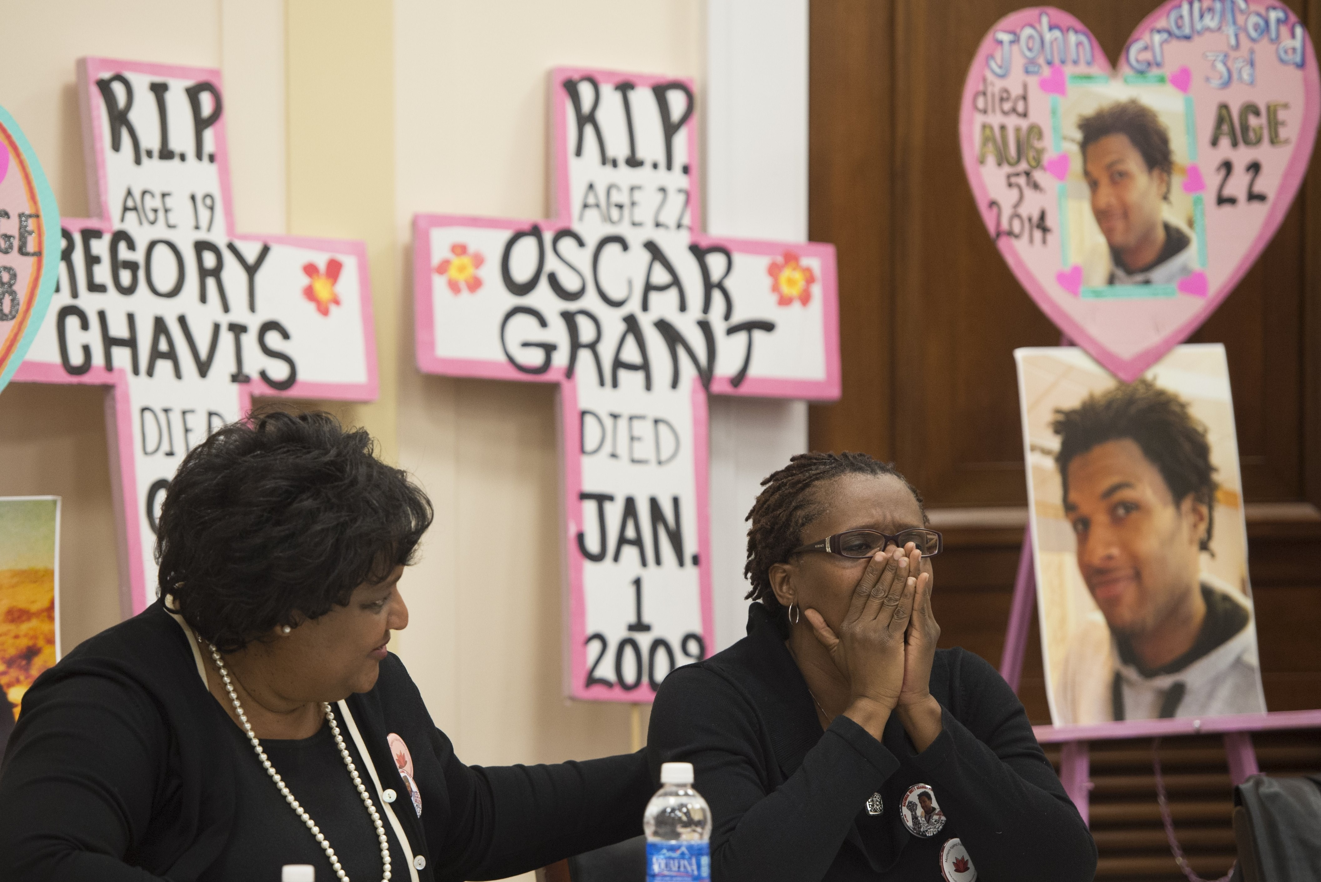 Mothers who have lost sons due to police action, including Tressa Sherrod (R), mother of 22-year-old John Crawford III, attend a press conference calling for police accountability and reform on Capitol Hill in Washington on Dec. 10, 2014.
