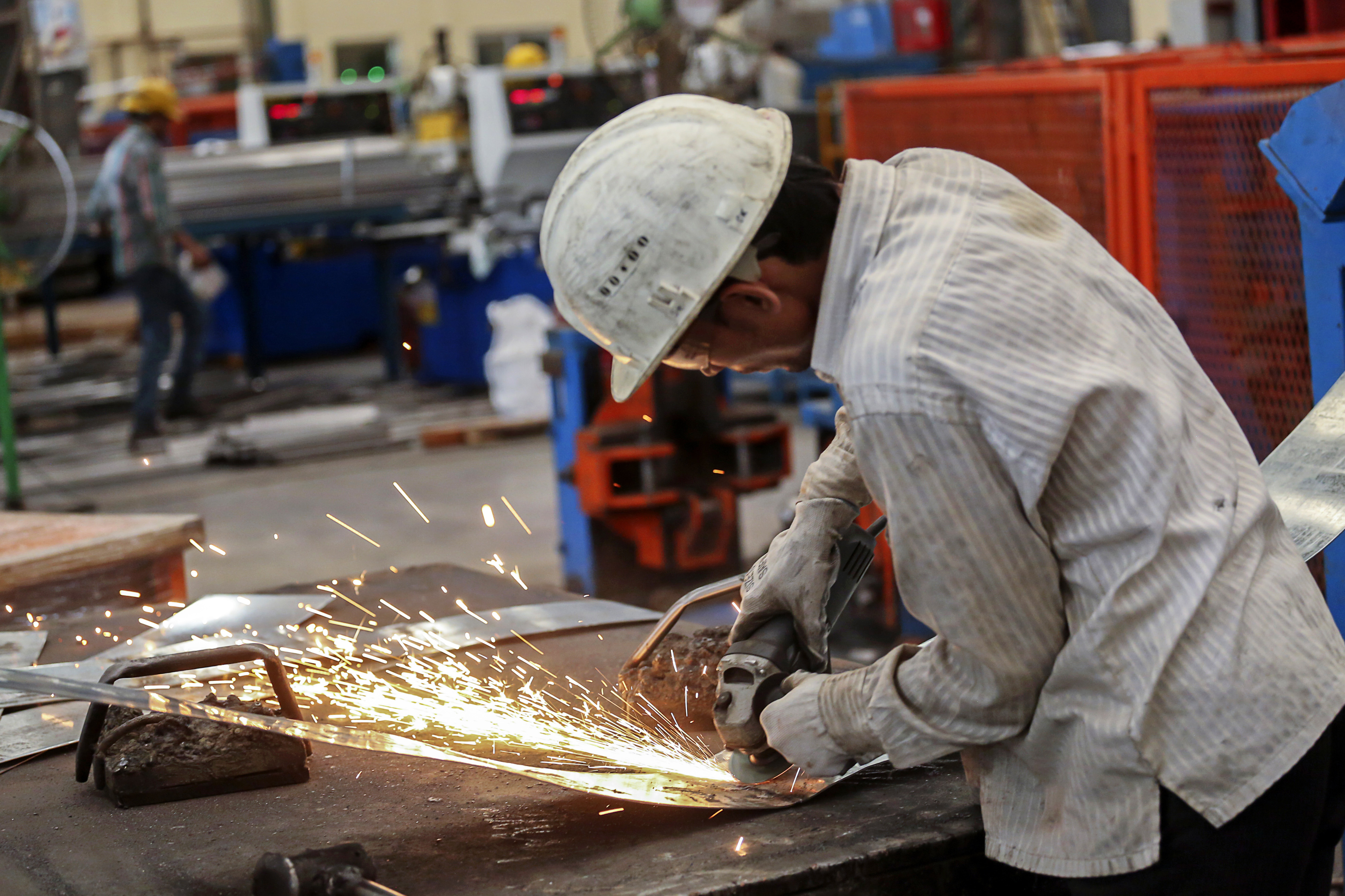 A worker at a company processing steel in Khopoli, India, in 2014.