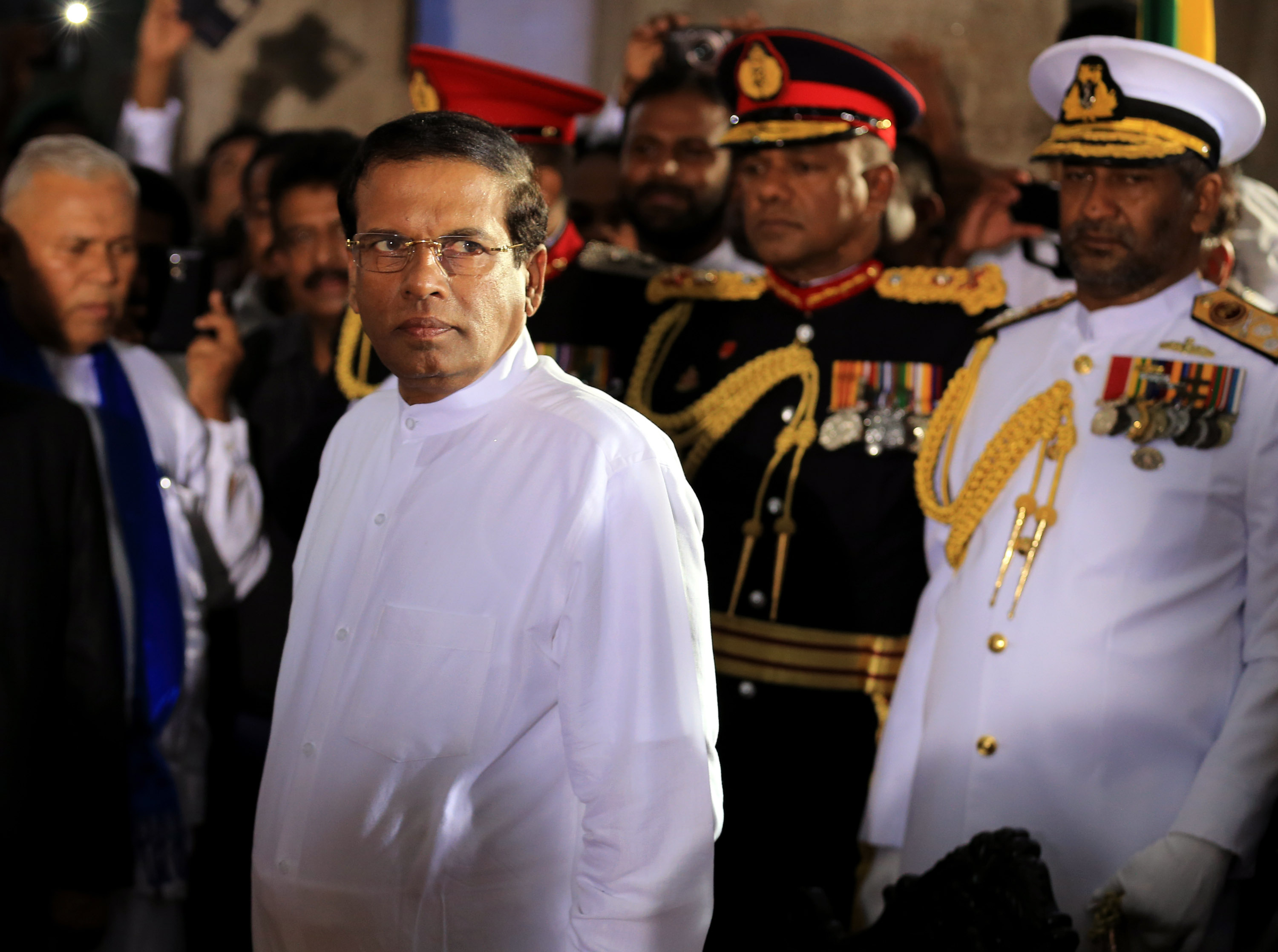 Sri Lanka's newly elected president Maithripala Sirisena (C) prepares to take oath as he is sworn in at Independence Square in Colombo on January 9, 2015 in Colombo, Sri Lanka.