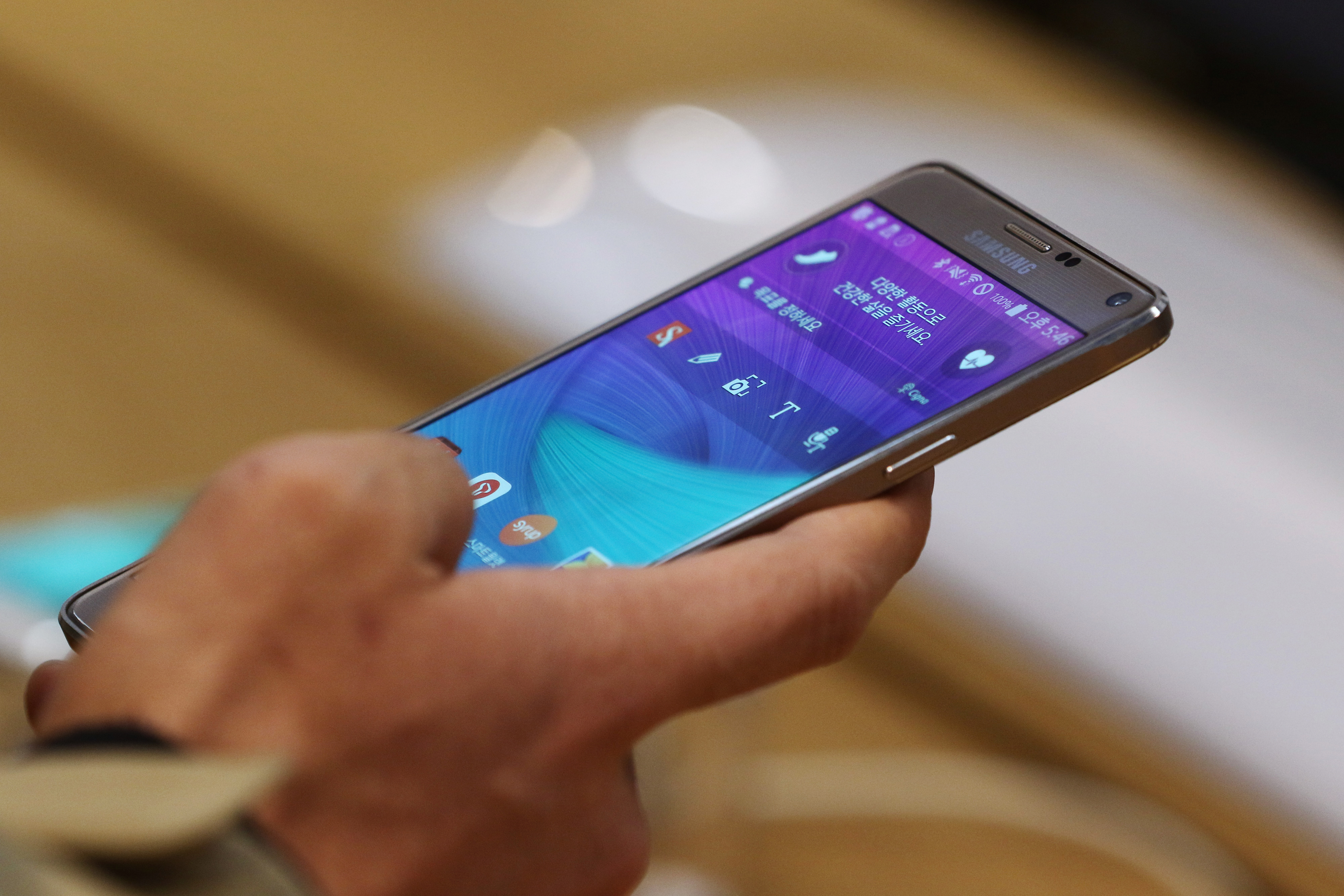 A visitor tries out a Samsung Electronics Co. Galaxy Note 4 smartphone at the company's d'light flagship store in Seoul, South Korea, on Tuesday, Jan. 27, 2015.
