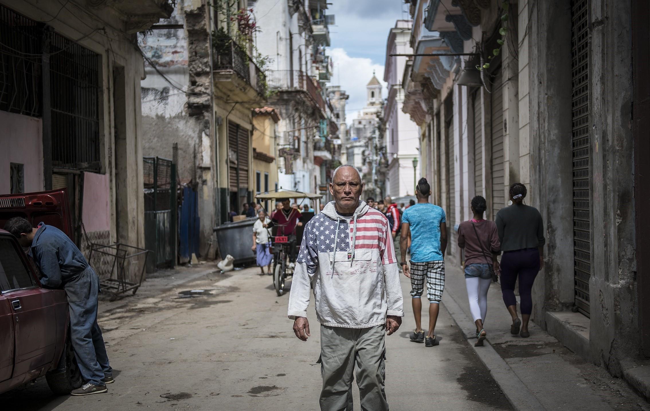 A man with American flag sweatshirt walking through a street in Havana on Feb. 14, 2015.
