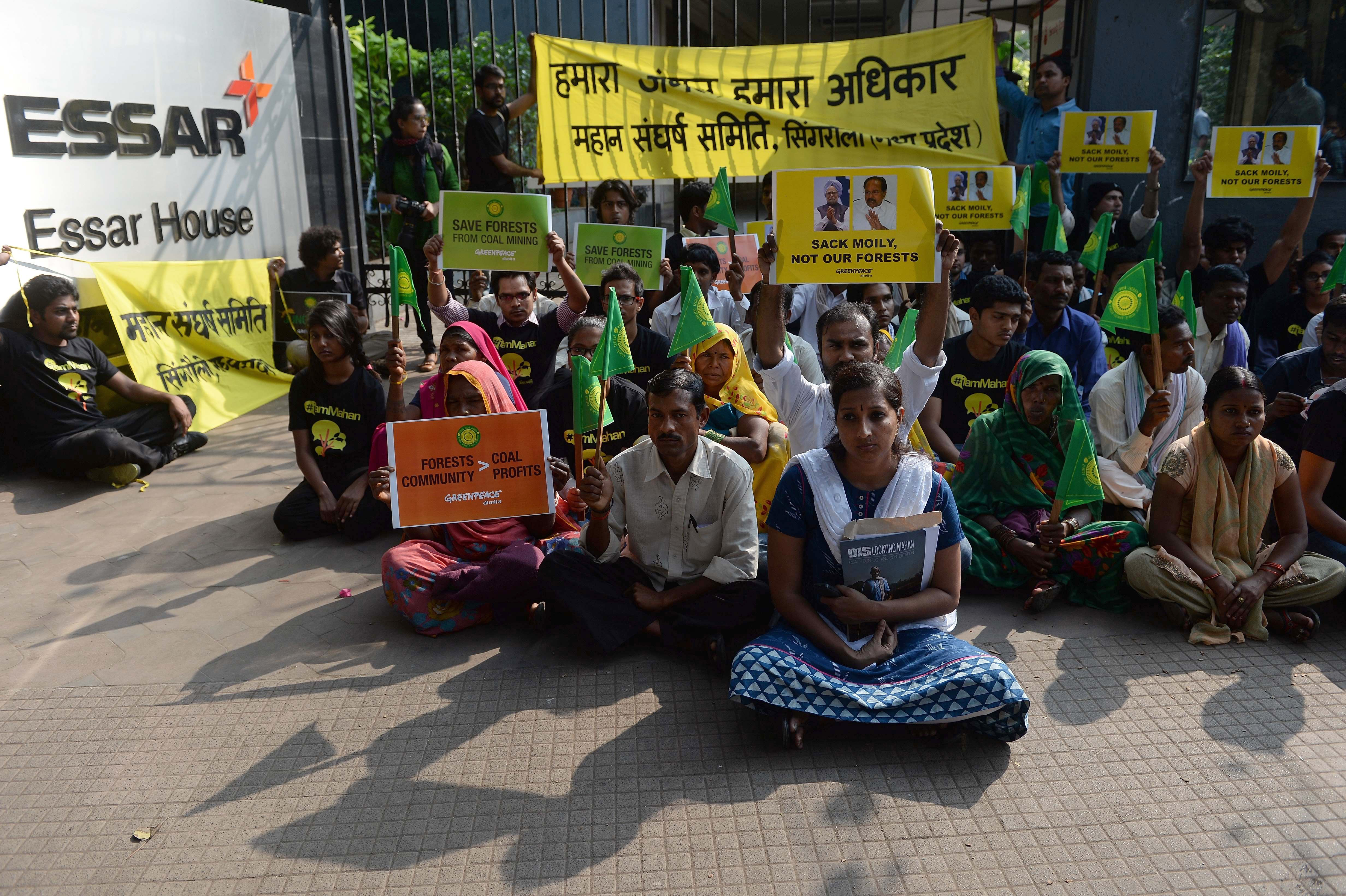 Activists from the environmental group Greenpeace and local farmers from Madhya Pradesh state sit outside the headquarters of India's Essar Group during a protest in Mumbai on Jan. 22, 2014
