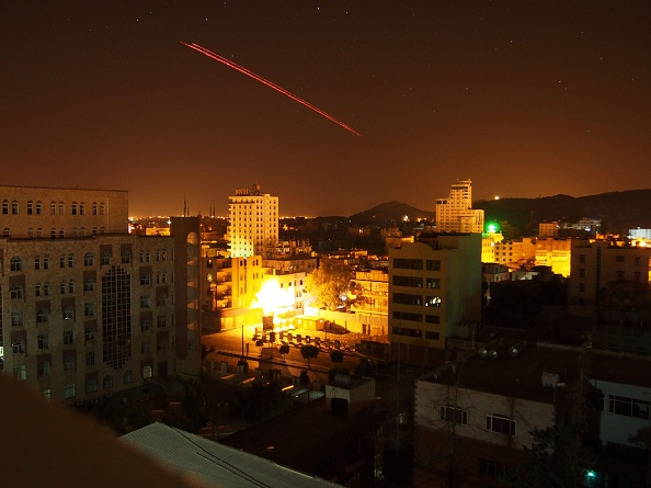 Houthis in the Yemeni city of Saana fire anti-aircraft weapons in the general direction of Saudi-led attacking warplanes March 30.