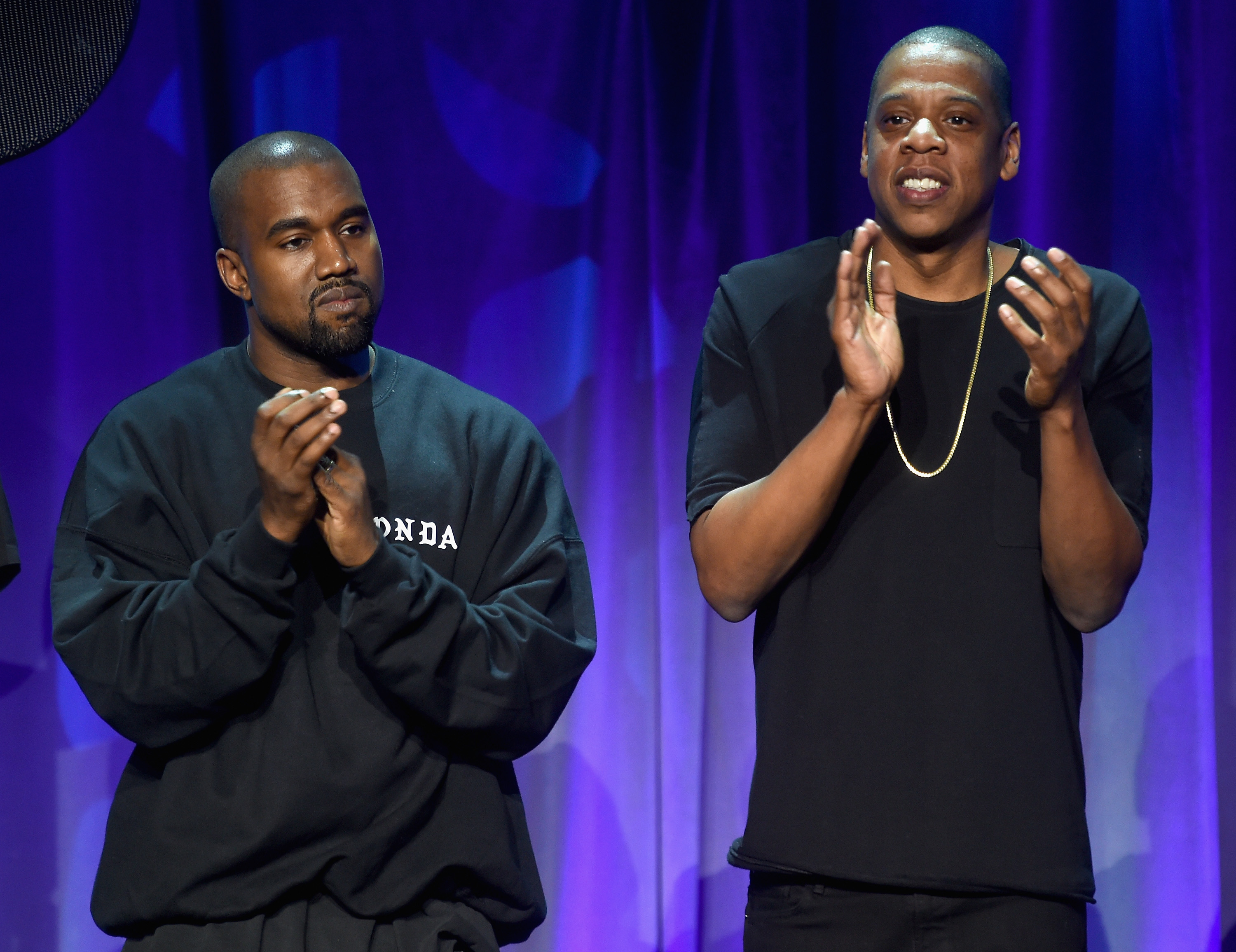 Kanye West (L) and JAY-Z onstage at the Tidal launch event #TIDALforALL at Skylight at Moynihan Station on March 30, 2015 in New York City.
