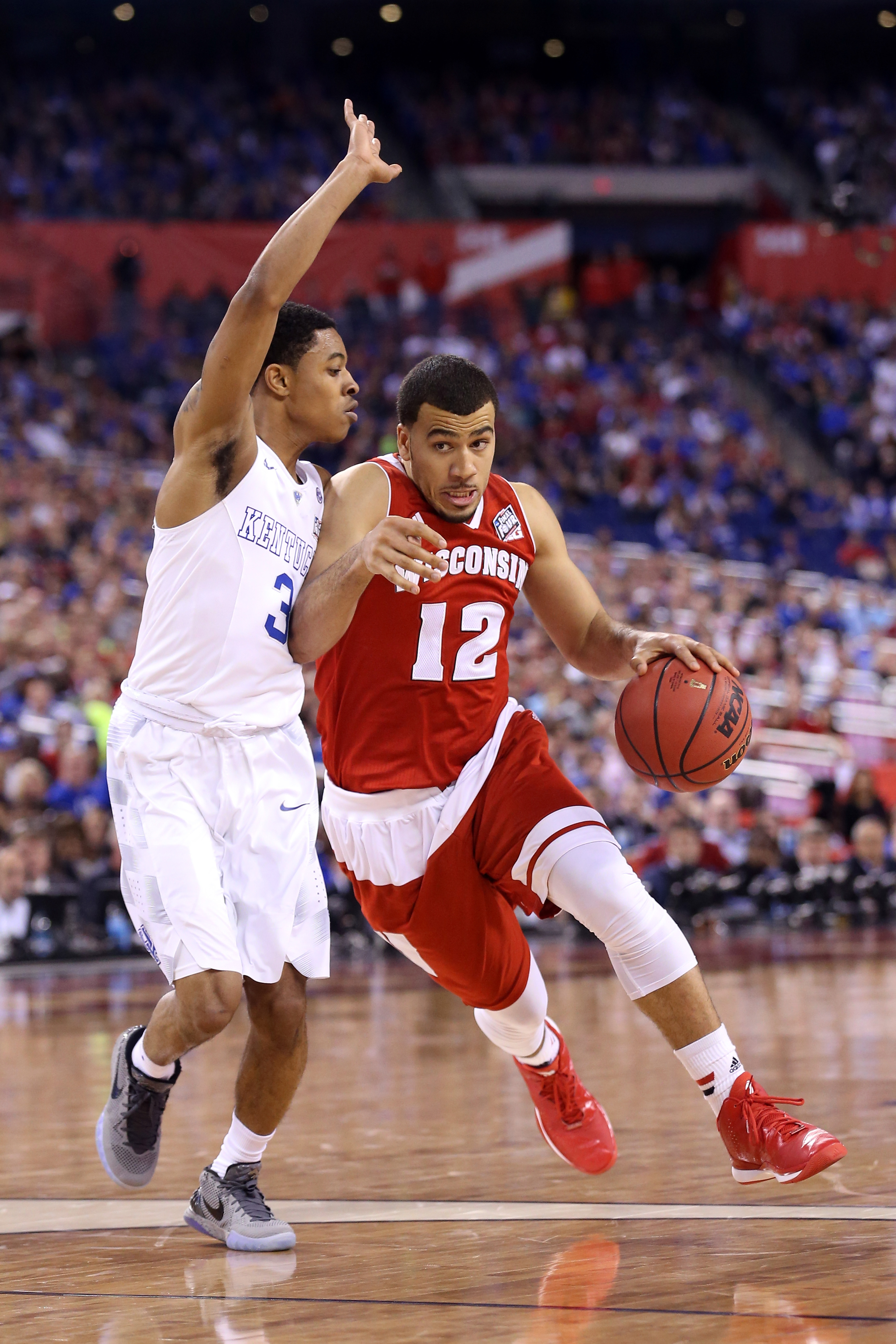 Traevon Jackson #12 of the Wisconsin Badgers handles the ball against Tyler Ulis #3 of the Kentucky Wildcats in the second half during the NCAA Men's Final Four Semifinal at Lucas Oil Stadium on April 4, 2015 in Indianapolis, Indiana.