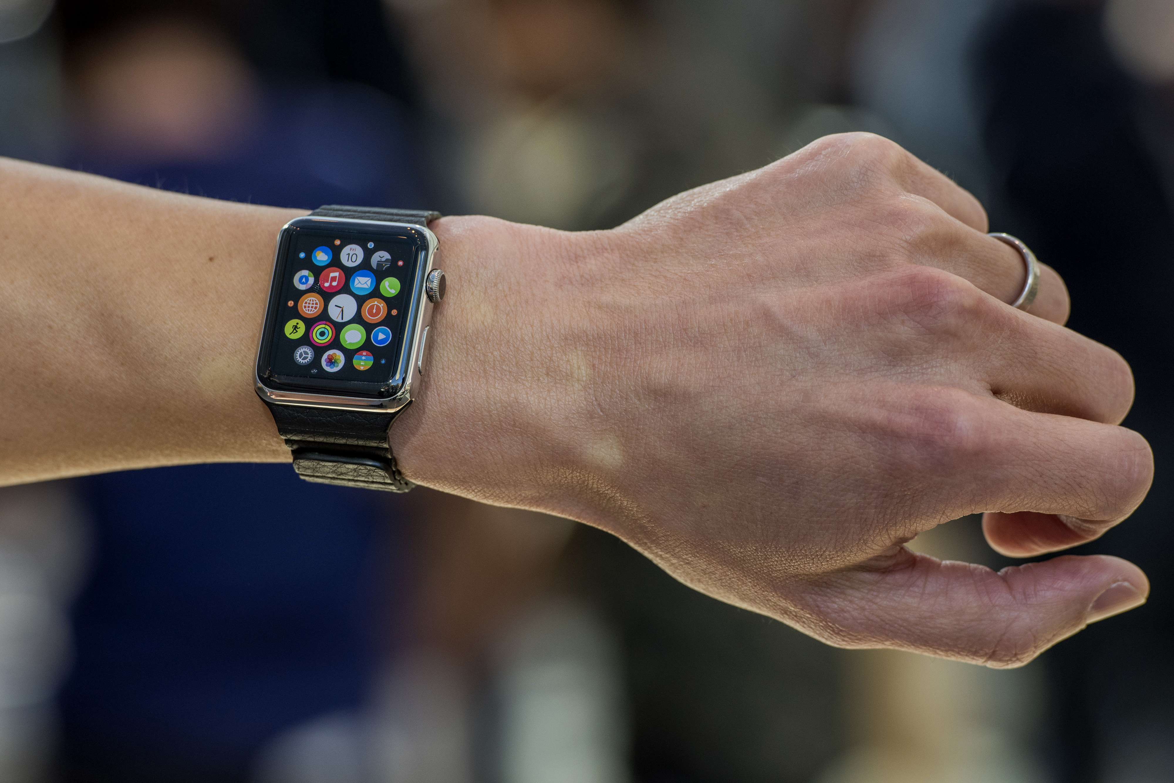 Customers look at Apple Watches on display at an Apple Inc. store in Palo Alto, California, U.S., on Friday, April 10, 2015.