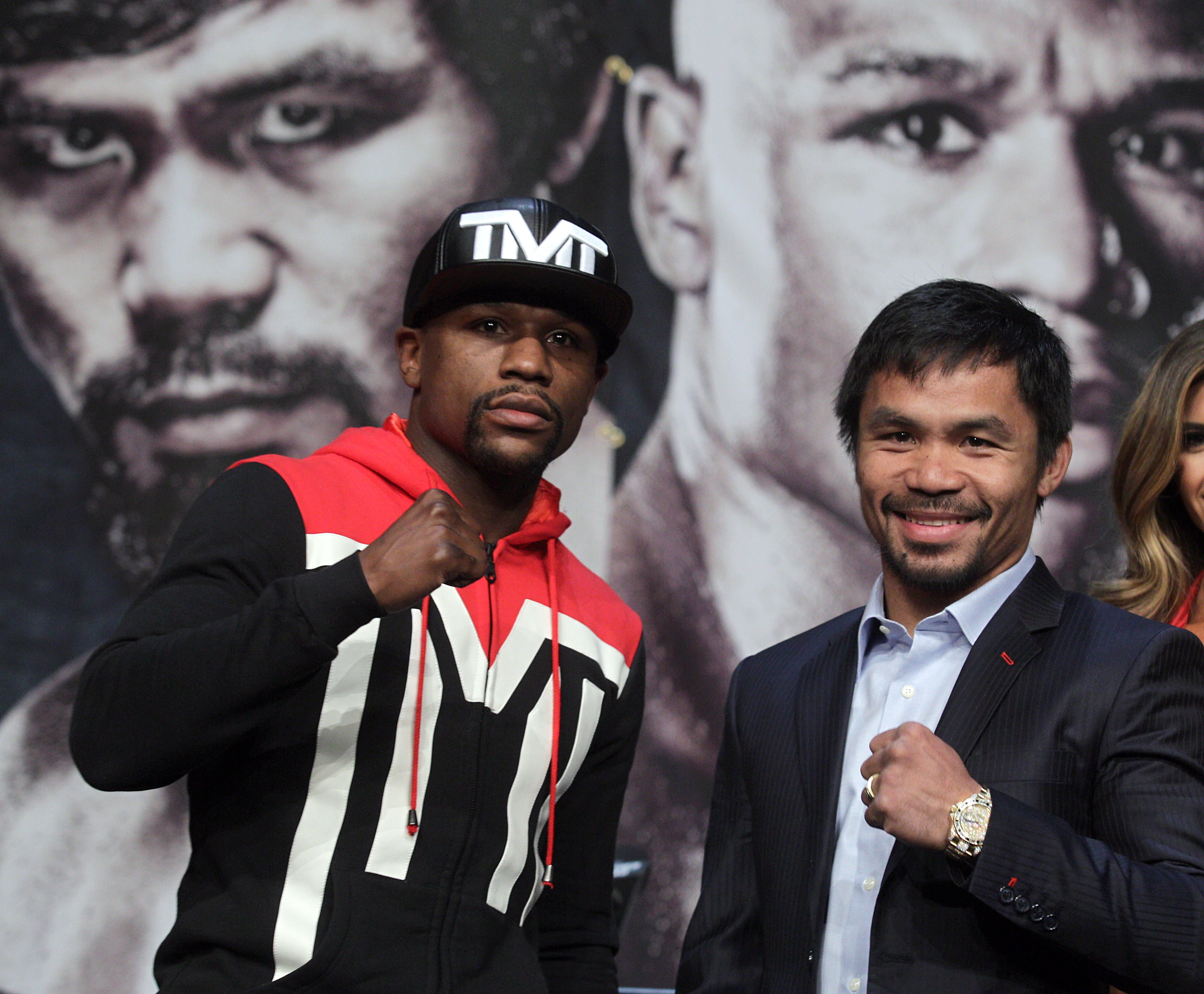 WBC/WBA welterweight champion Floyd Mayweather Jr. (L) and WBO welterweight champion Manny Pacquiao pose during a news conference at the KA Theatre at MGM Grand Hotel & Casino on April 29, 2015 in Las Vegas, Nevada. The two will face each other in a unification bout on May 2, 2015 in Las Vegas.