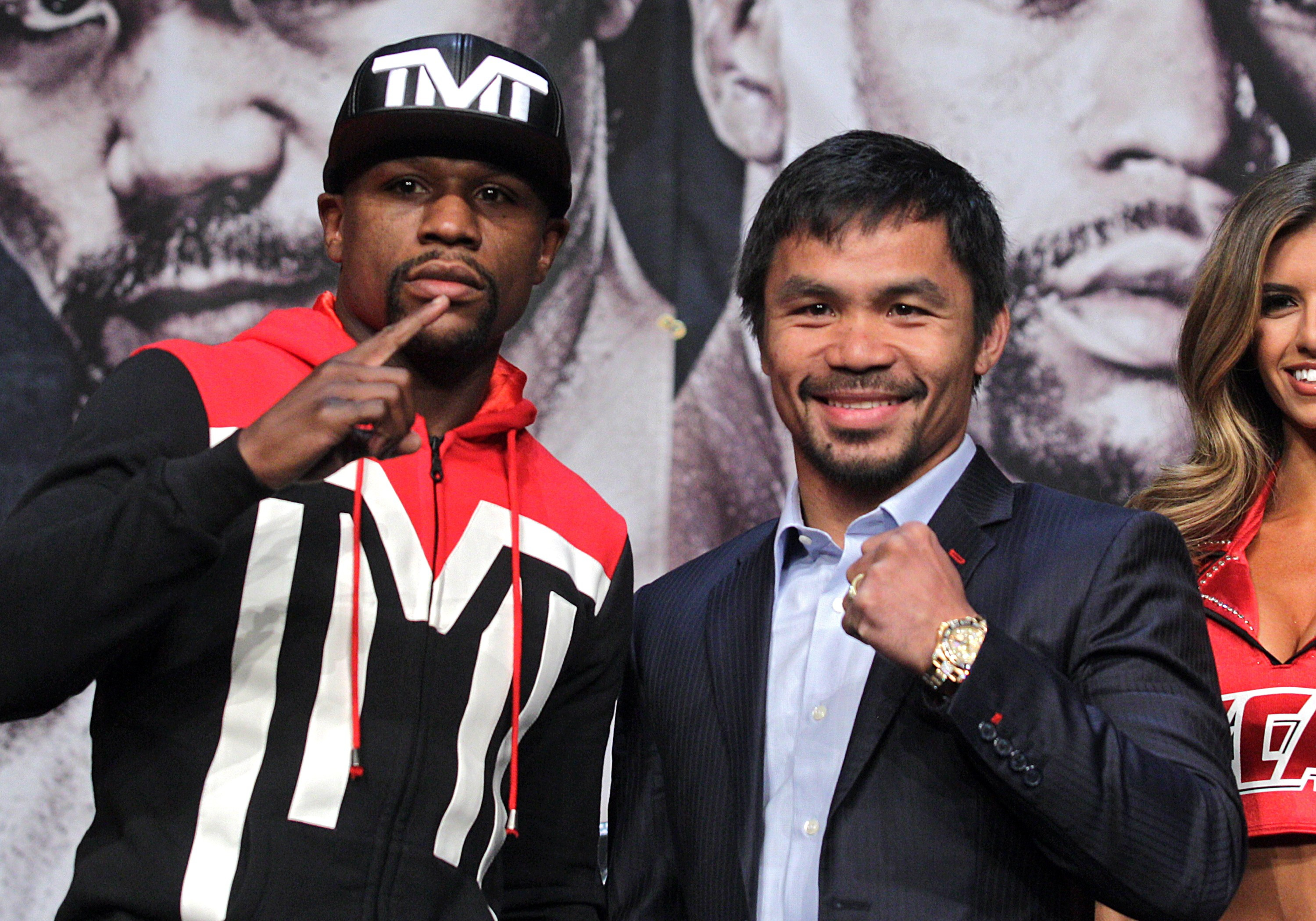WBC/WBA welterweight champion Floyd Mayweather Jr. (L) and WBO welterweight champion Manny Pacquiao pose during a news conference at the KA Theatre at MGM Grand Hotel & Casino on April 29, 2015 in Las Vegas, Nevada.