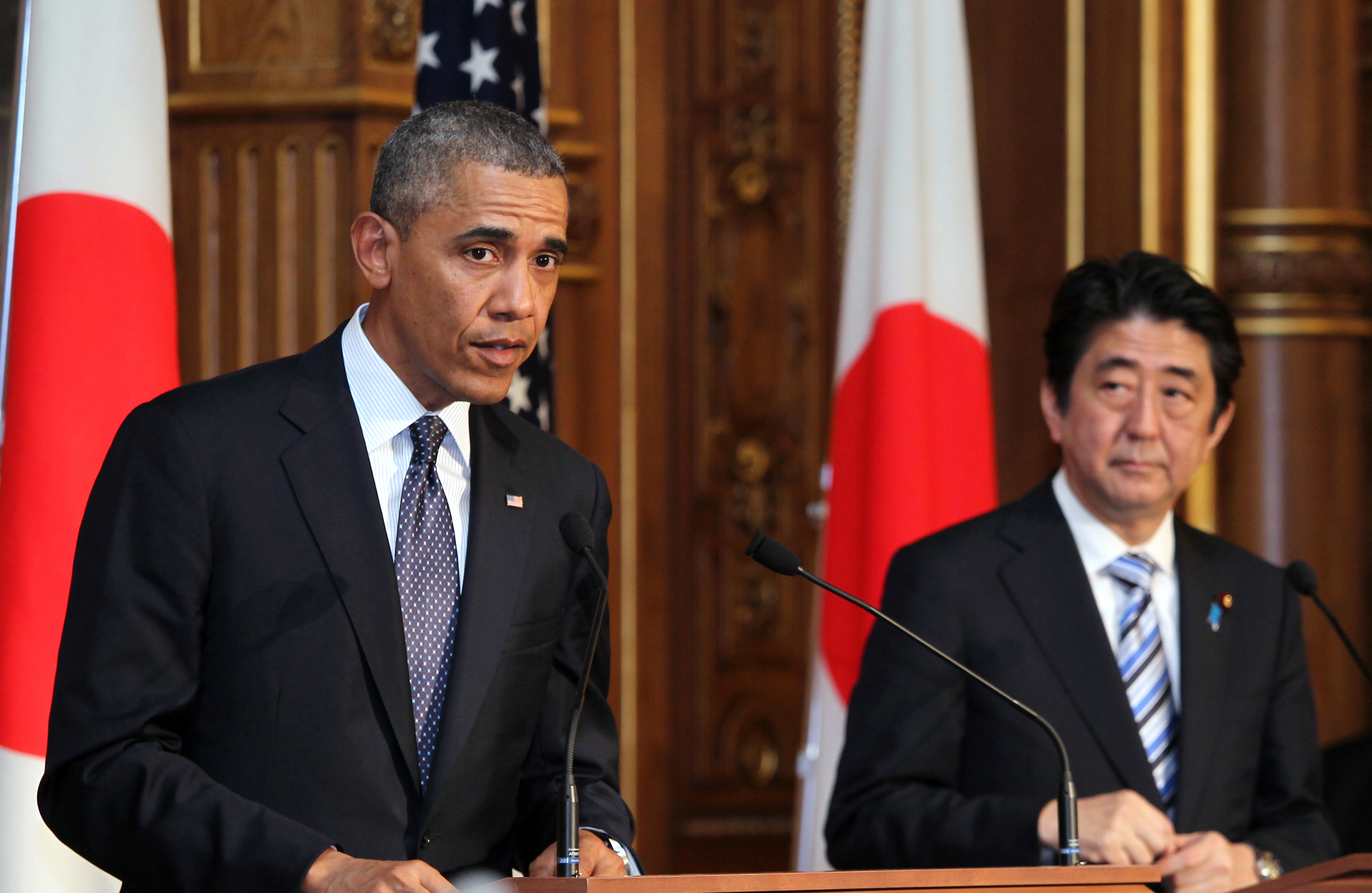 U.S. President Barack Obama, left, speaks as Shinzo Abe, Japan's prime minister, looks on during a joint news conference at the State Guest House in Tokyo, Japan, on Thursday, April 24, 2014.