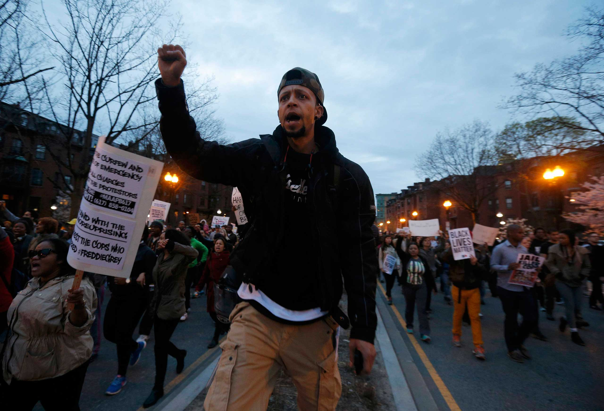 People march in protest against police violence in Boston on April 29, 2015.