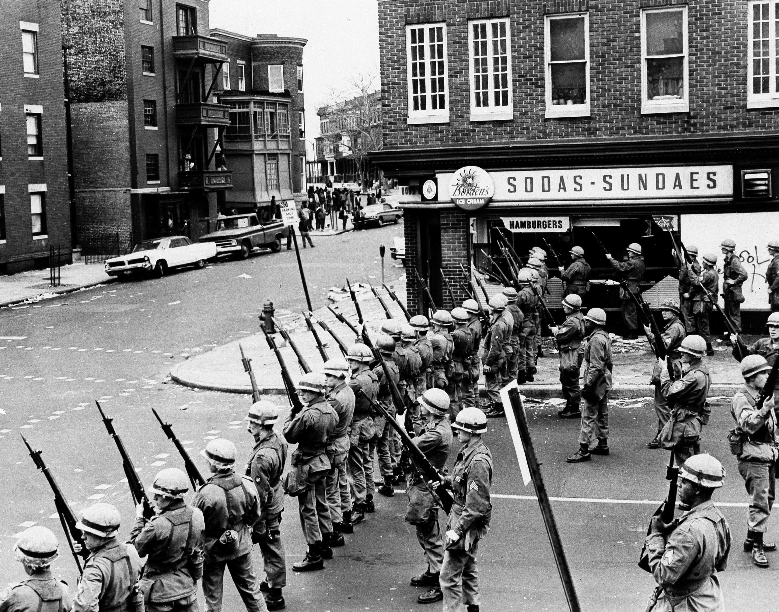 National Guardsmen seal off a business-residential section of Baltimore and prepare to use tear gas against looters on April 8, 1968.