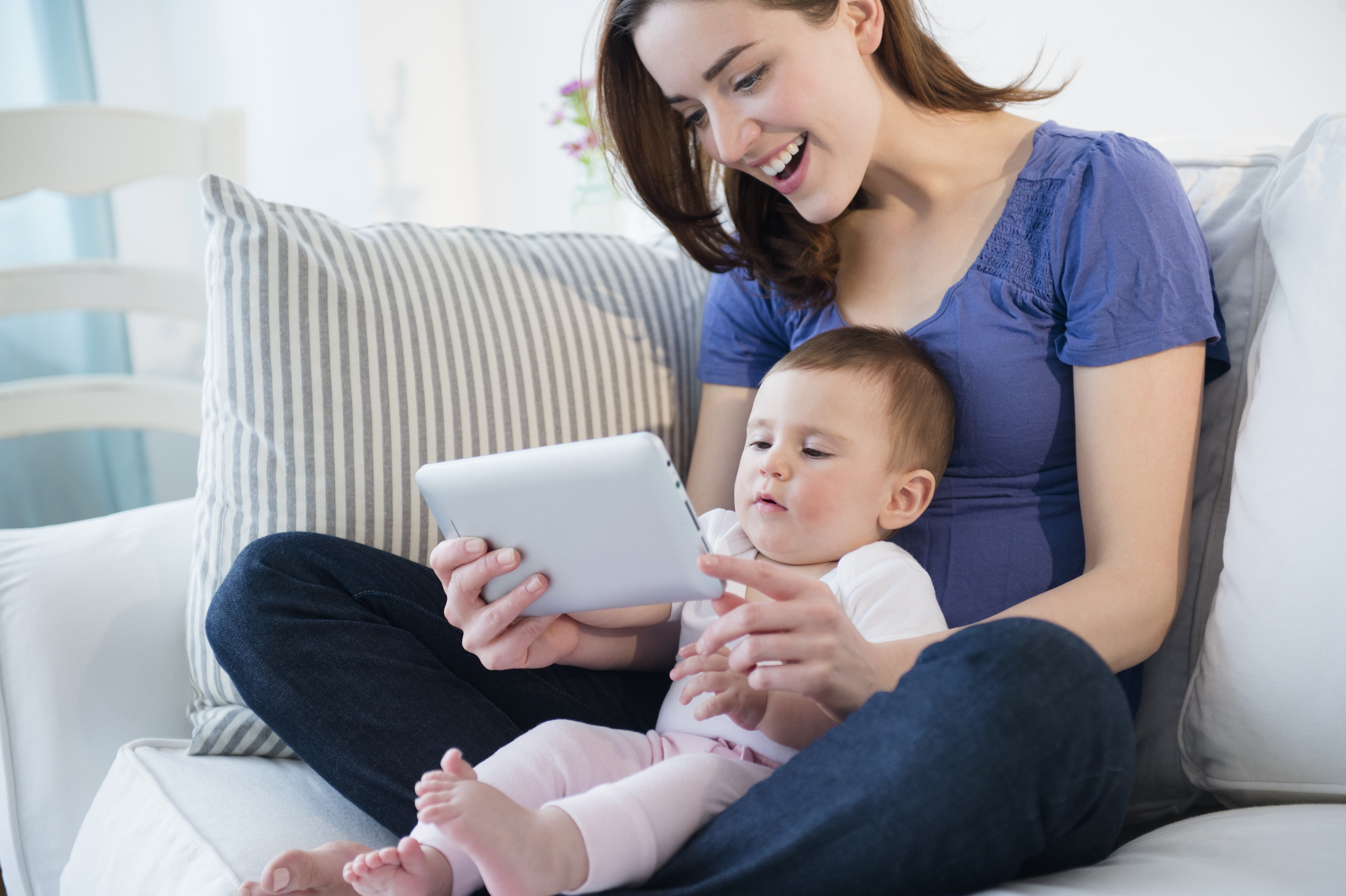 Mother and baby using digital tablet