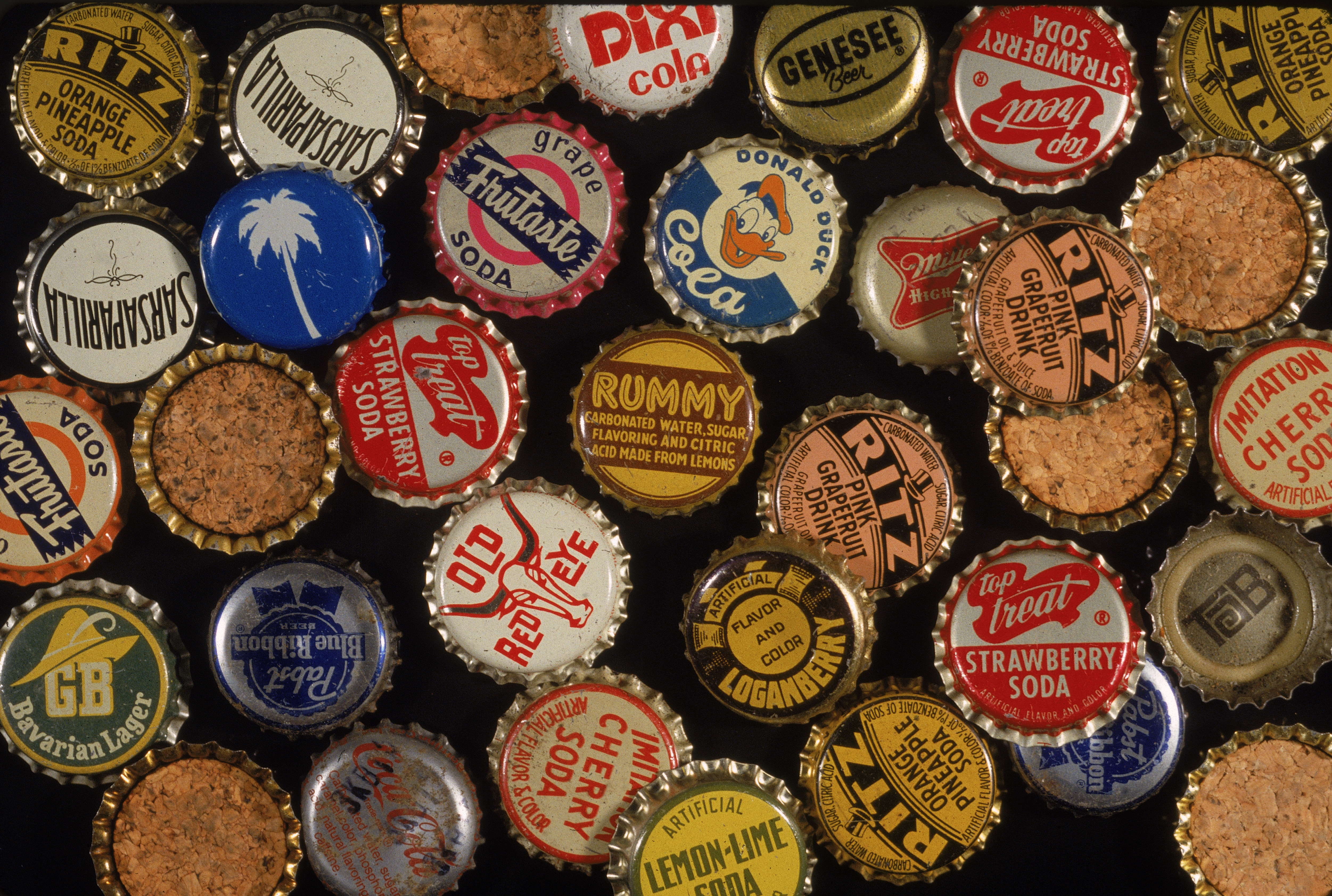 An assortment of American soda, juice, and beer bottle caps mostly from the 1950s and early 1960s. Some are flipped-over to show cork backing. (Photo by Blank Archives/Getty Images)