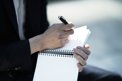 businessman-taking-notes