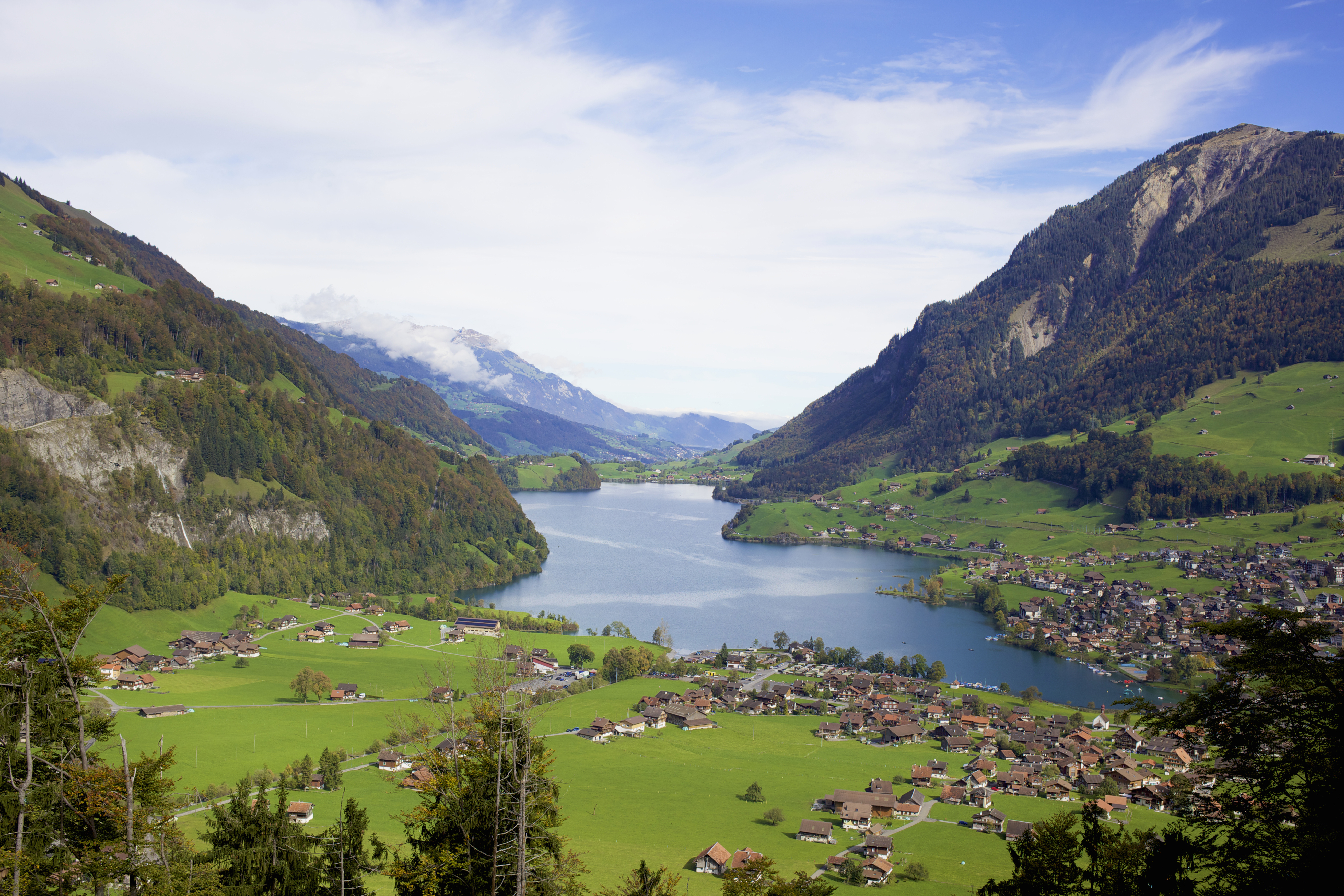 View of mountains and lakeside village, Switzerland