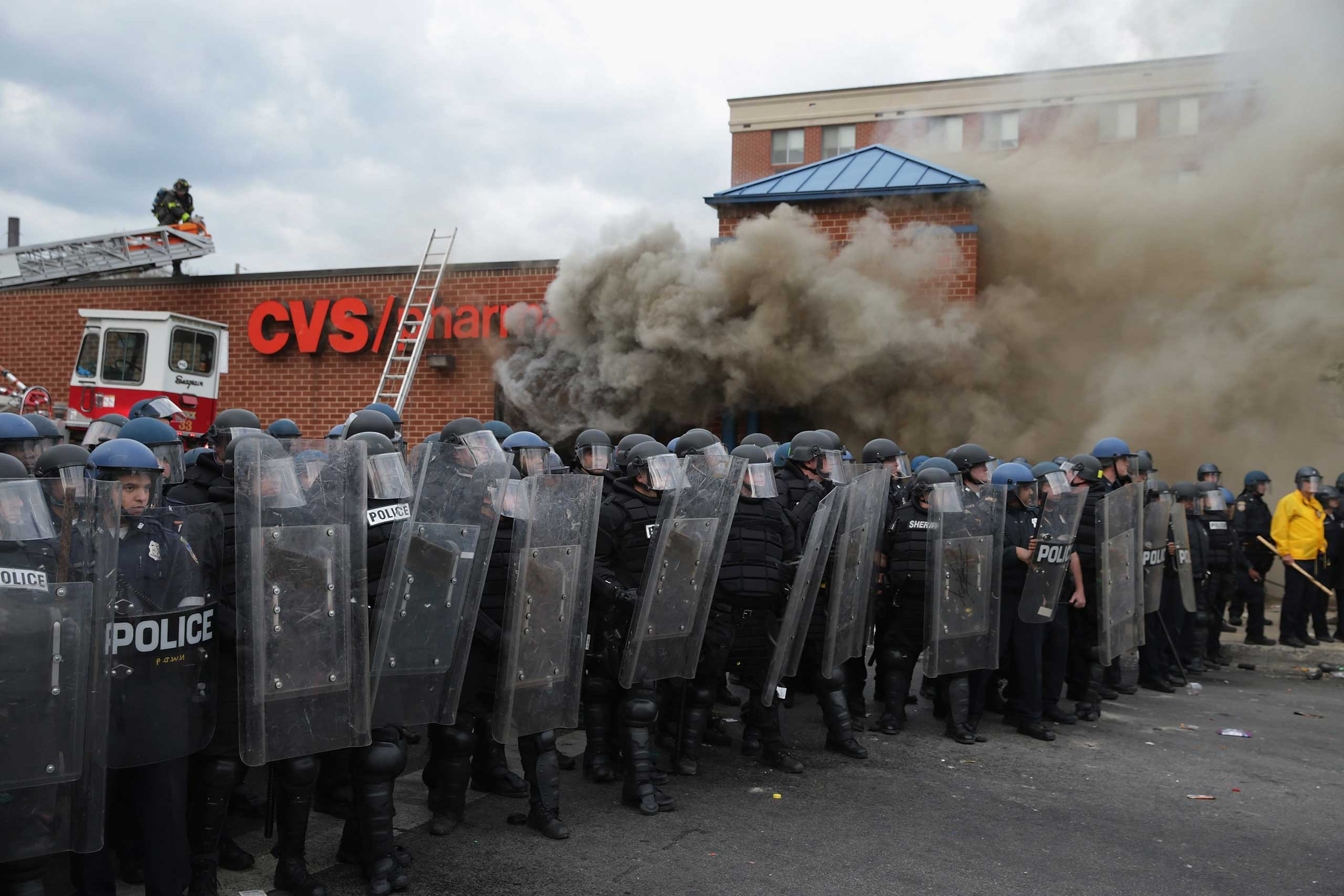 Baltimore Police form a perimeter around a CVS pharmacy that was looted and burned in Baltimore on April 27, 2015.
