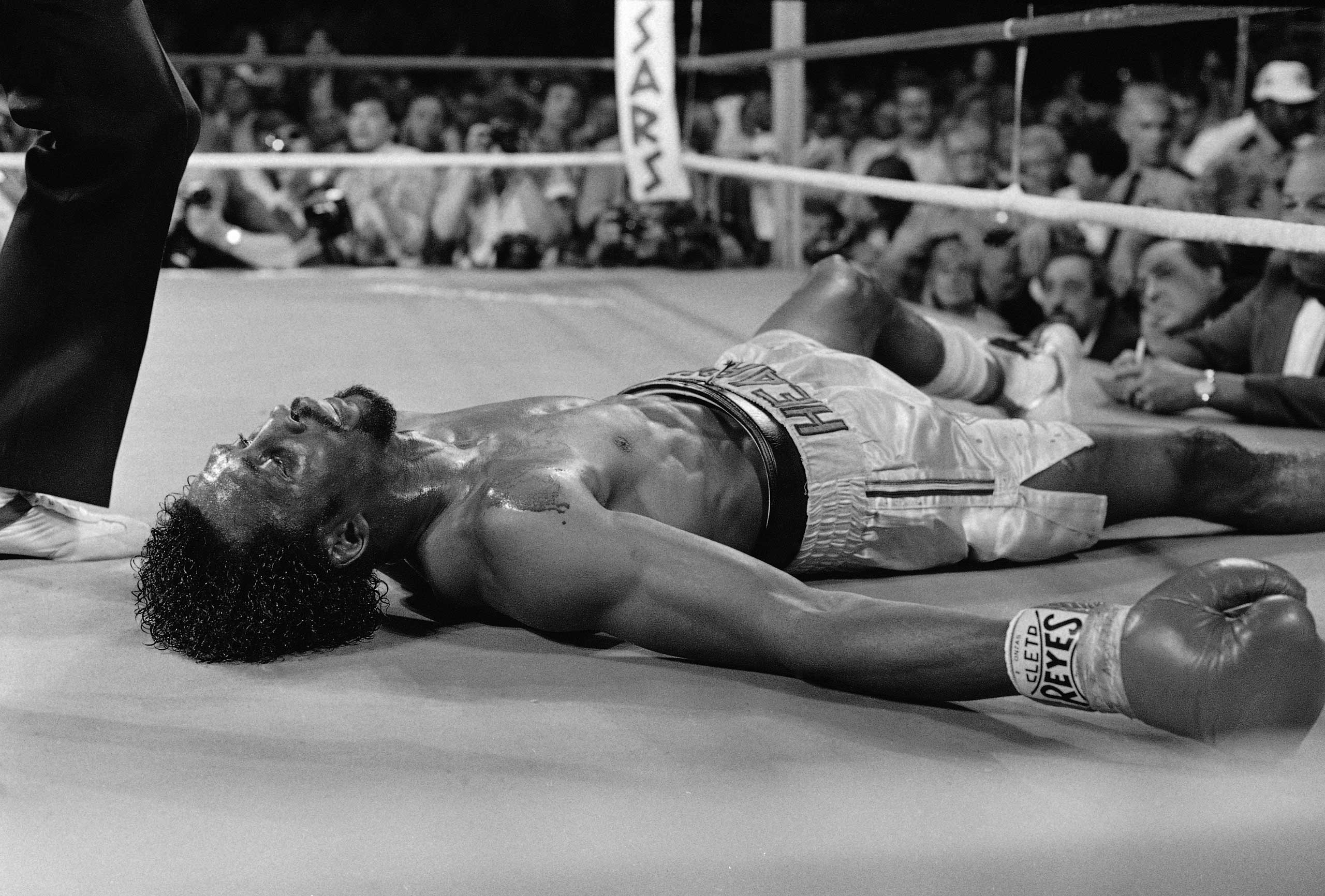 "<b>Marvin Hagler vs. Thomas Hearns, April 15, 1985</b> Arguably the greatest opening round in boxing history, the savage pace set by ""Marvellous"" Marvin and the ""Hitman"" at Caesars Palace is still discussed to this day. At the time, sportscaster Barry Tompkins, calling the fight for HBO, yelled out ""This is still only the first round!"" Of course they couldn't keep it up and the aptly named ""War"" came to a swift end after, in the words of Ring Magazine, the ""most electrifying eight minutes ever"" as Hagler scored a third-round KO. The enduring image of a blood soaked Hagler being carried around the ring in victory with Hearns being taken back to his corner in a state of semi-consciousness serves to remind us what a brutal sport this can be."