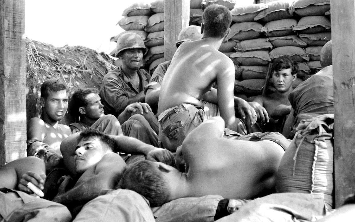 "Bunker, 1967: ""Troops of the 77th Field Artillery, 25th Infantry Division hunker down in a partially completed bunker to escape the mayhem of 3,600 of our own 105mm Howitzer rounds light off at knee level in all directions. The enemy was watching all this, but could not attack us."""