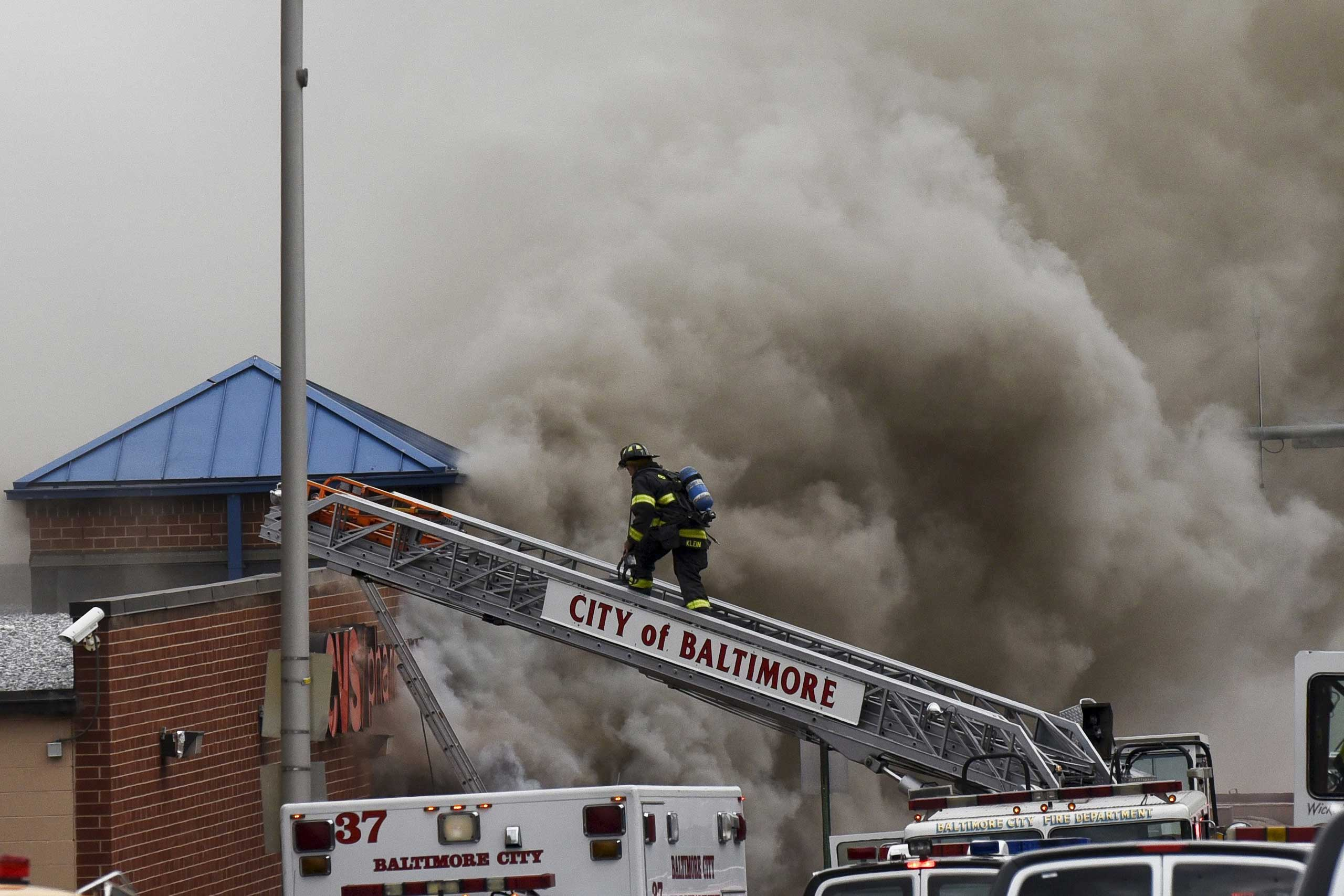 Fire fighters respond to a fire at a CVS pharmacy in Baltimore on April 27, 2015.