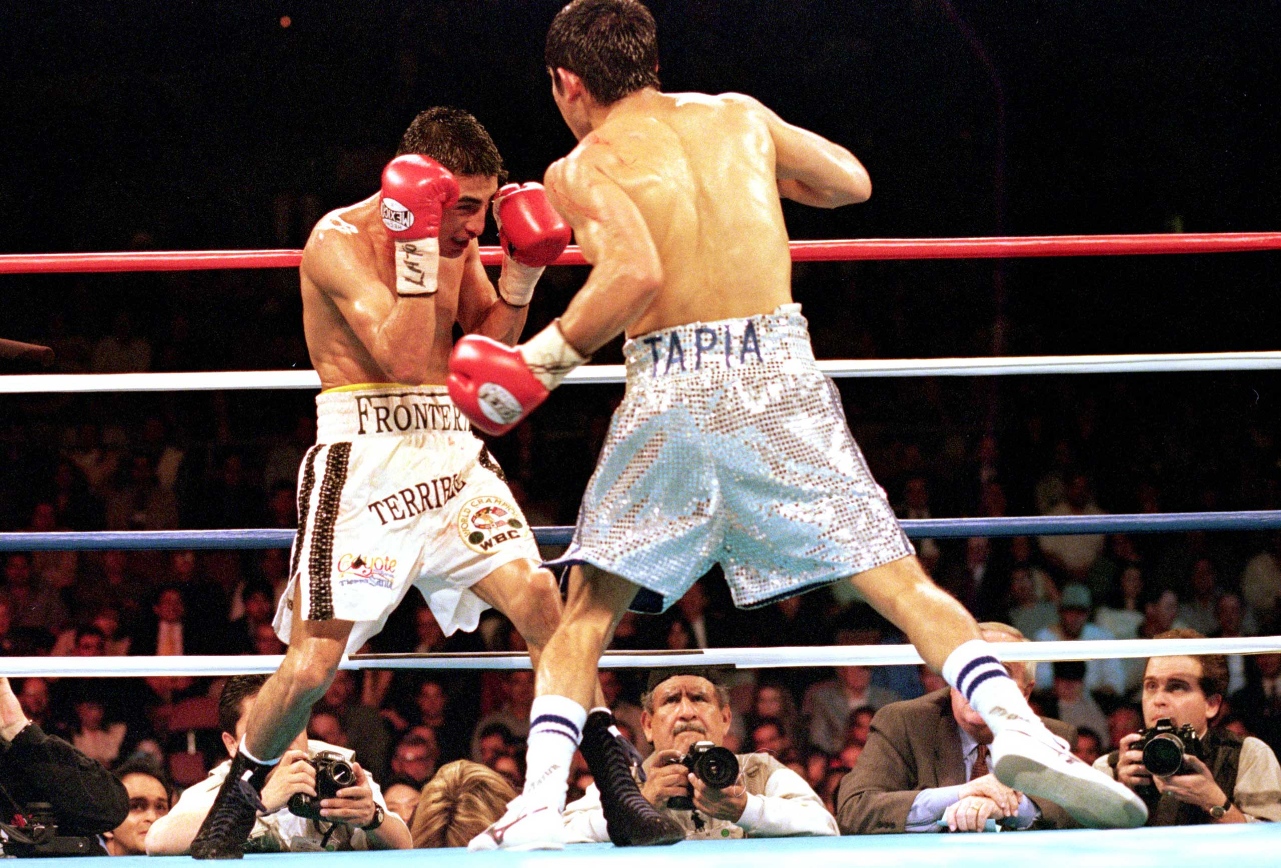 <b>Erik Morales vs. Marco Antonio Barrera I, Feb. 19, 2000</b> Mexicans beam with pride when recalling their countrymen's epic effort back at the turn of the century. Ring Magazine's fight of 2000 was fully justified as the slender boxers belied their small stature to deliver a heavyweight performance which didn't relent (the fifth round has to be seen to be believed) and resulted in Morales winning by a split decision. But considering that Barrera had the only knockdown of the fight, many complained at the outcome which — quelle surprise — led to a rematch (won by Barrera via a unanimous outcome). Cue the third fight (this time at Super Featherweight) where Barrera was declared the winner by a majority decision.