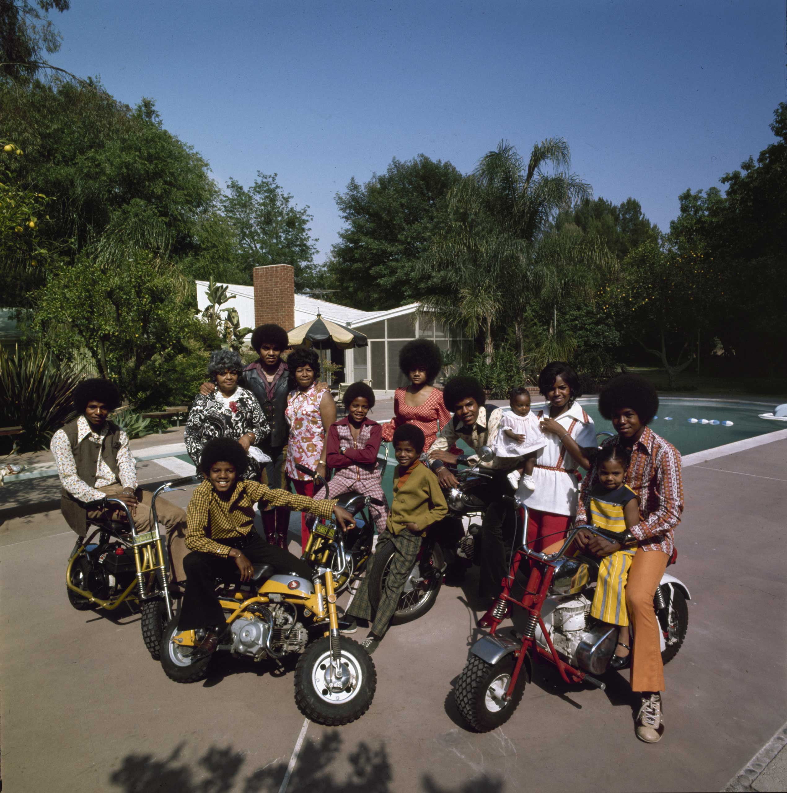 THE JACKSONS: While the Jacksons faded from view, youngest brother Michael (on yellow bike) rose to international stardom and ignominy.