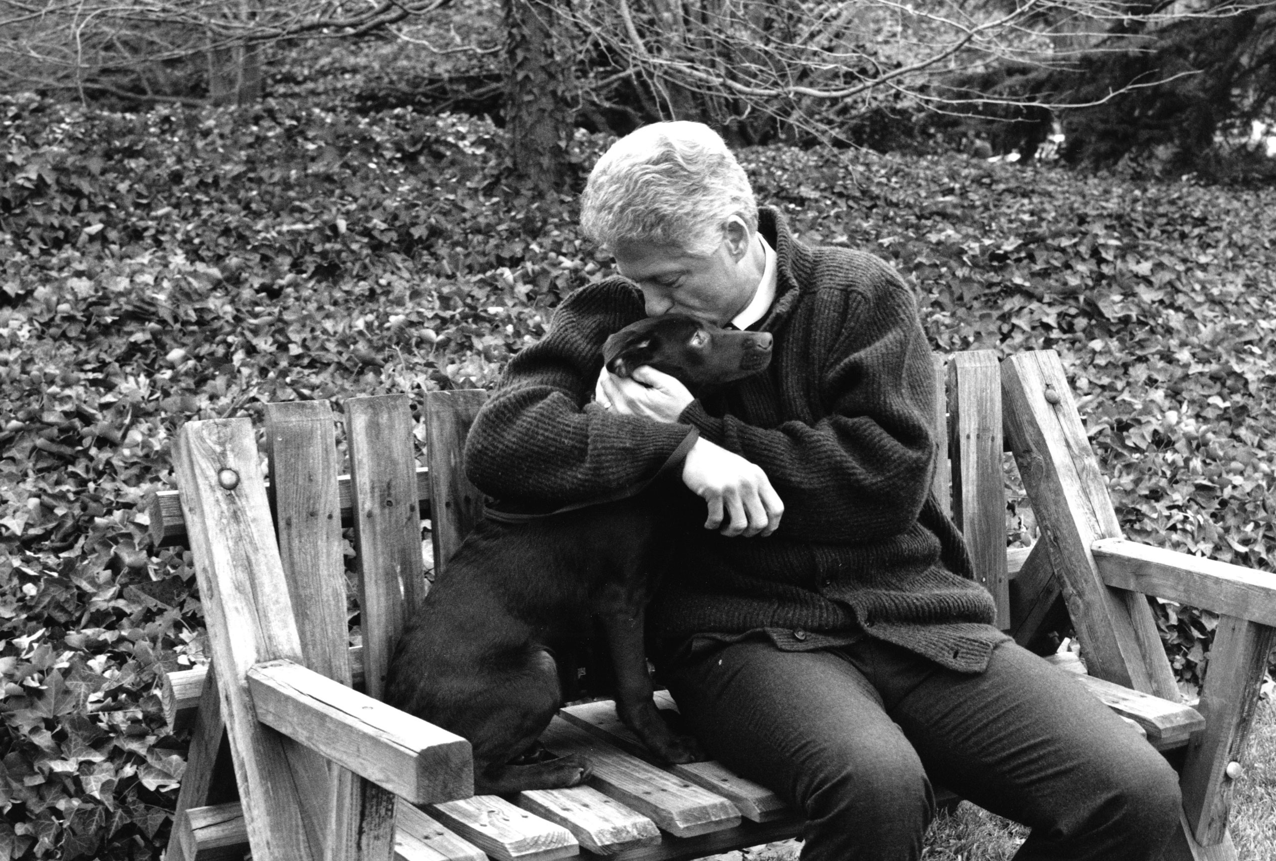 """The first time President Clinton met Buddy, the chocolate lab that became the family's pet. He took the dog on a walk around the South Lawn. """"I asked the President if I could accompany them so I could take photos,"""" says Barbara Kinney."""