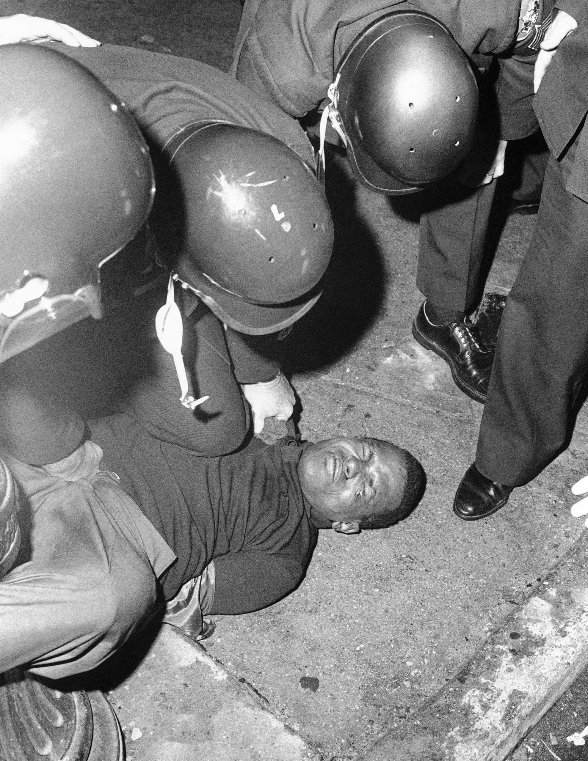 Baltimore City police pin down a curfew breaker in Baltimore on April 9, 1968.