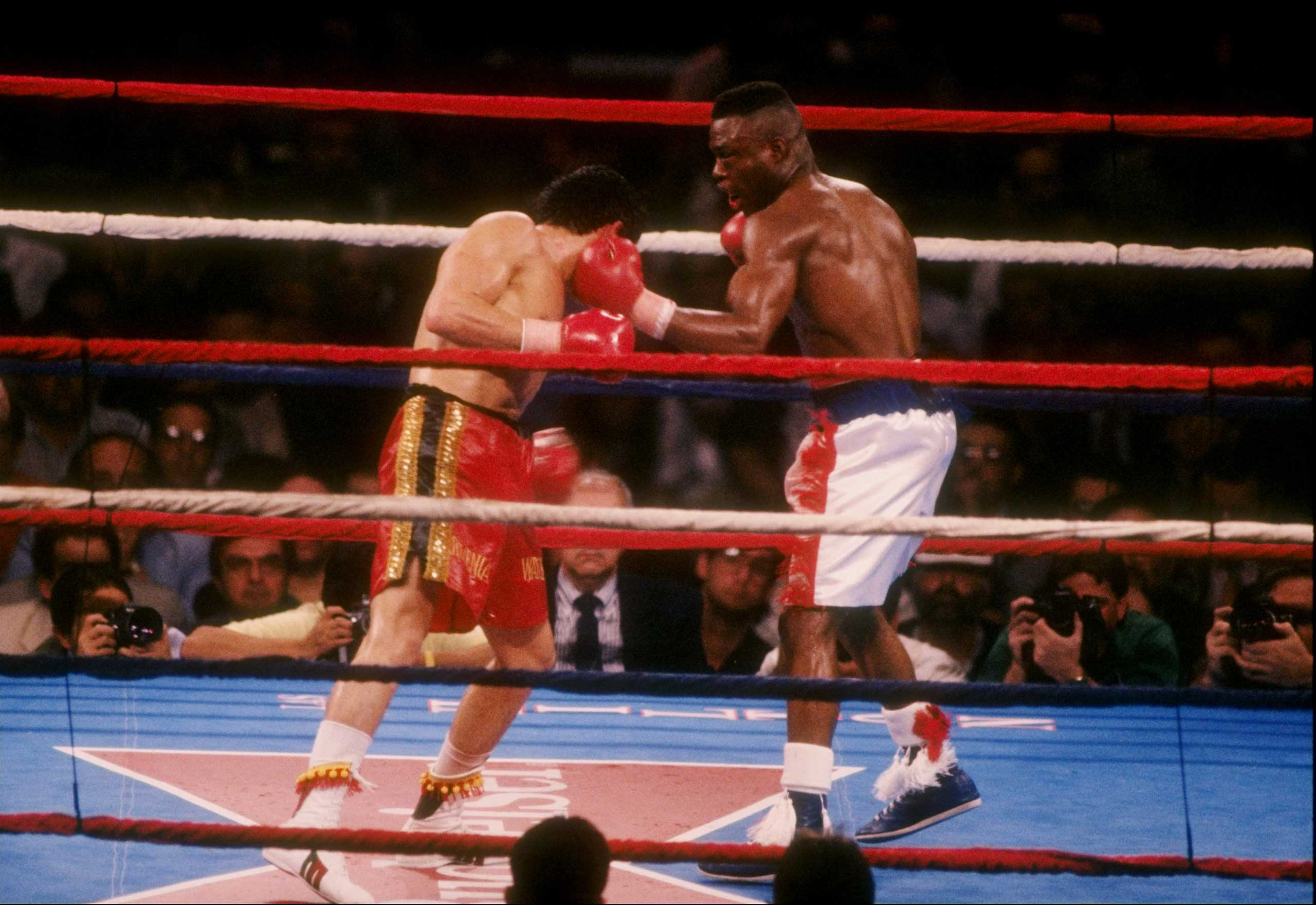 "<b>Julio Cesar Chavez vs. Meldrick Taylor, March 17, 1990</b> Endings don't get much more dramatic than this. Expectations were high for the bout nicknamed ""Thunder Meets Lightning"", referring to Chavez's punching power and Taylor's speed. And while the fight definitely delivered, it enters folklore for the nature of the sudden, dramatic, and controversial ending that continues to be debated to this day. Taylor steadily built a commanding lead on points thanks to easily evading his opponent and outpunching him by a margin of 5-1. But when Chavez did manage to connect, his punches did considerable damage as a result of being the heavier man.                                                                      Going into the 12th, Taylor was ahead on all three scorecards (and by a big margin on two of them) but for some reason, Taylor's trainer Lou Duva told his man that he needed to win the final round. Bad move: Taylor was so tired that he fell to the canvas just by failing to land a wild left hand. The final minute was all Chavez and he dropped Taylor with seconds remaining. Taylor got to his feet and was asked by referee Richard Steel if he was able to continue. By not answering (though some say Taylor gave a slight nod), Steele concluded he was unfit to carry on and stopped the fight, scoring a TKO victory for Chavez with only two seconds to go. No wonder his 2009 autobiography was called Two Seconds From Glory."