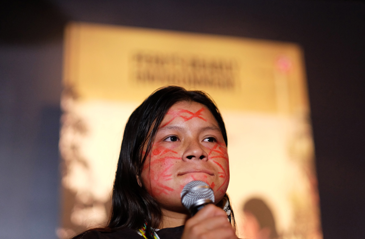 Diana Rios Rengifo, the daughter of one of the four indigenous Ashéninka leaders murdered in the Peruvian Amazon in early September, speaks during a ceremony in New York on Nov. 17, 2014
