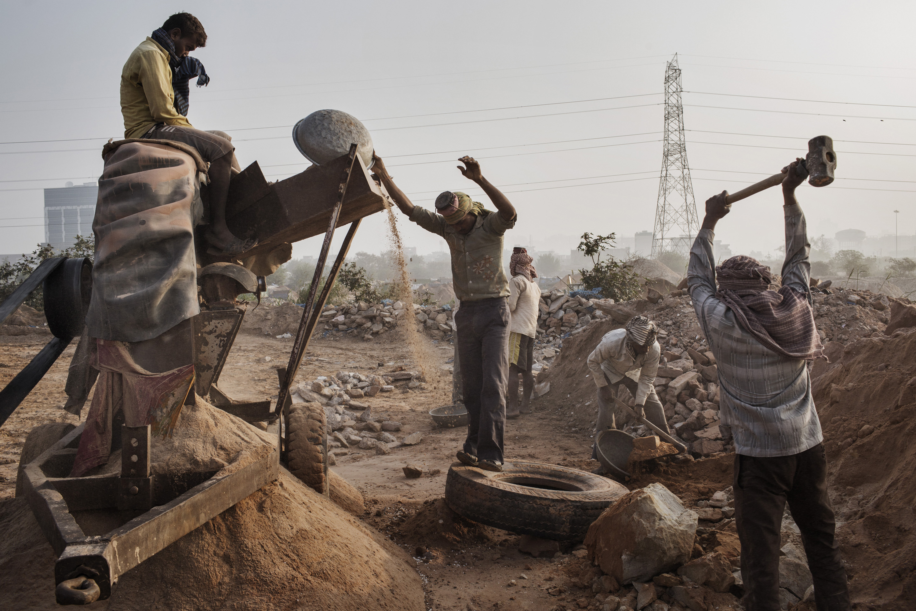WIRED: The Deadly Global War for Sand Indian workers crush stone into sand at an illegal mine near Raipur Village in India on March 18, 2015.